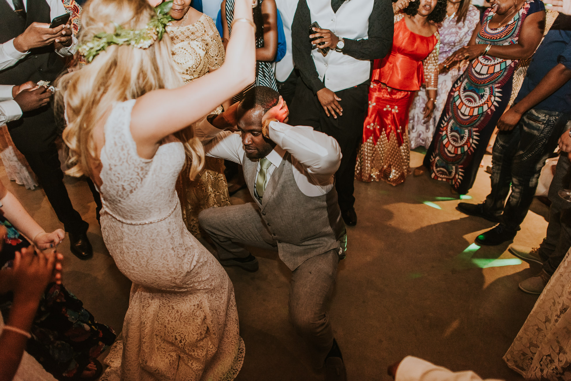 groom dancing with bride photographed by Traverse the Tides