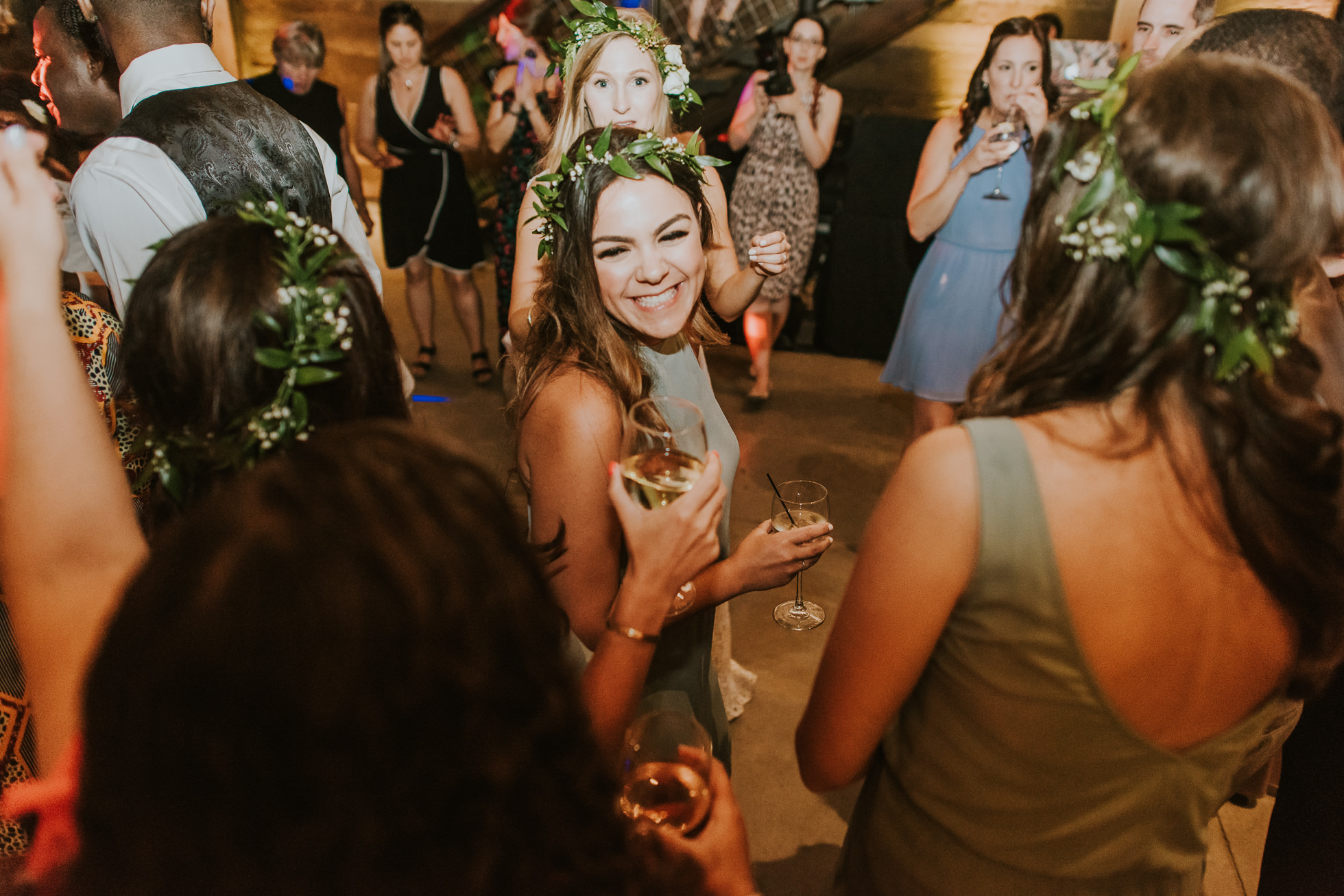 bridesmaids dancing photographed by Traverse the Tides