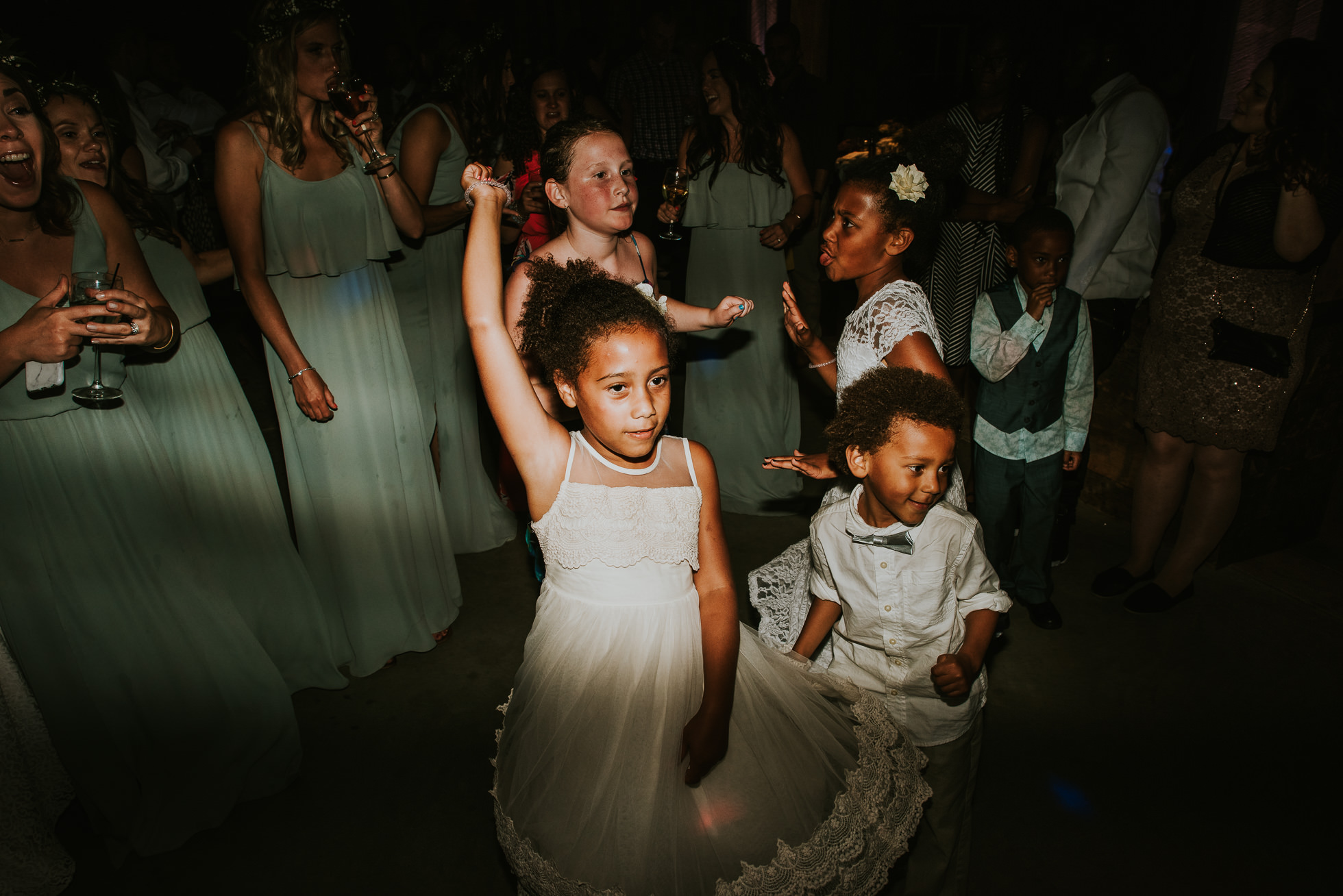 flower girl and ring bearer dancing photographed by Traverse the Tides