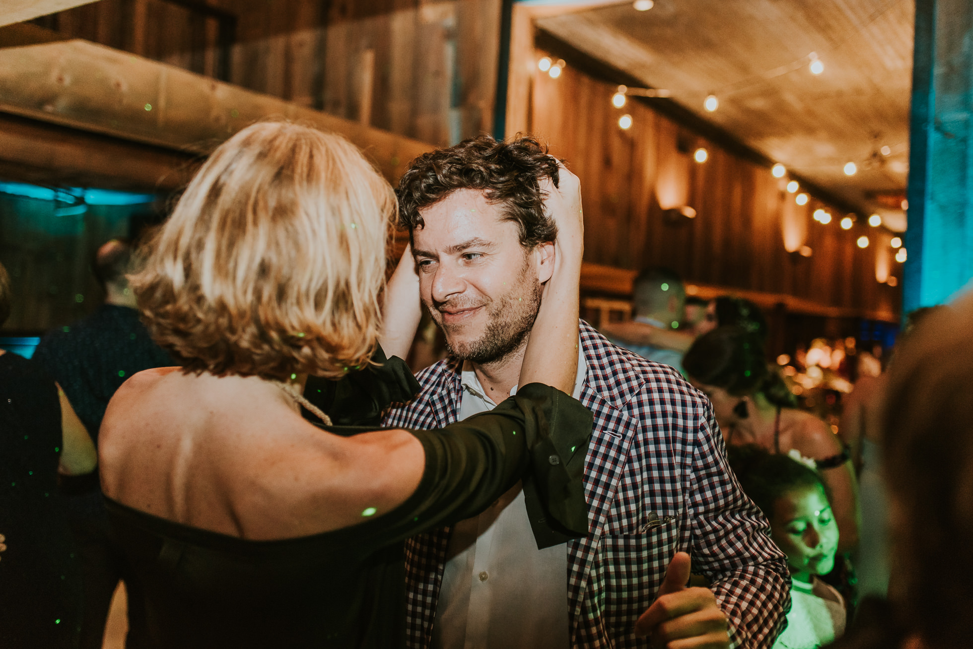 drunk wedding guests photographed by Traverse the Tides