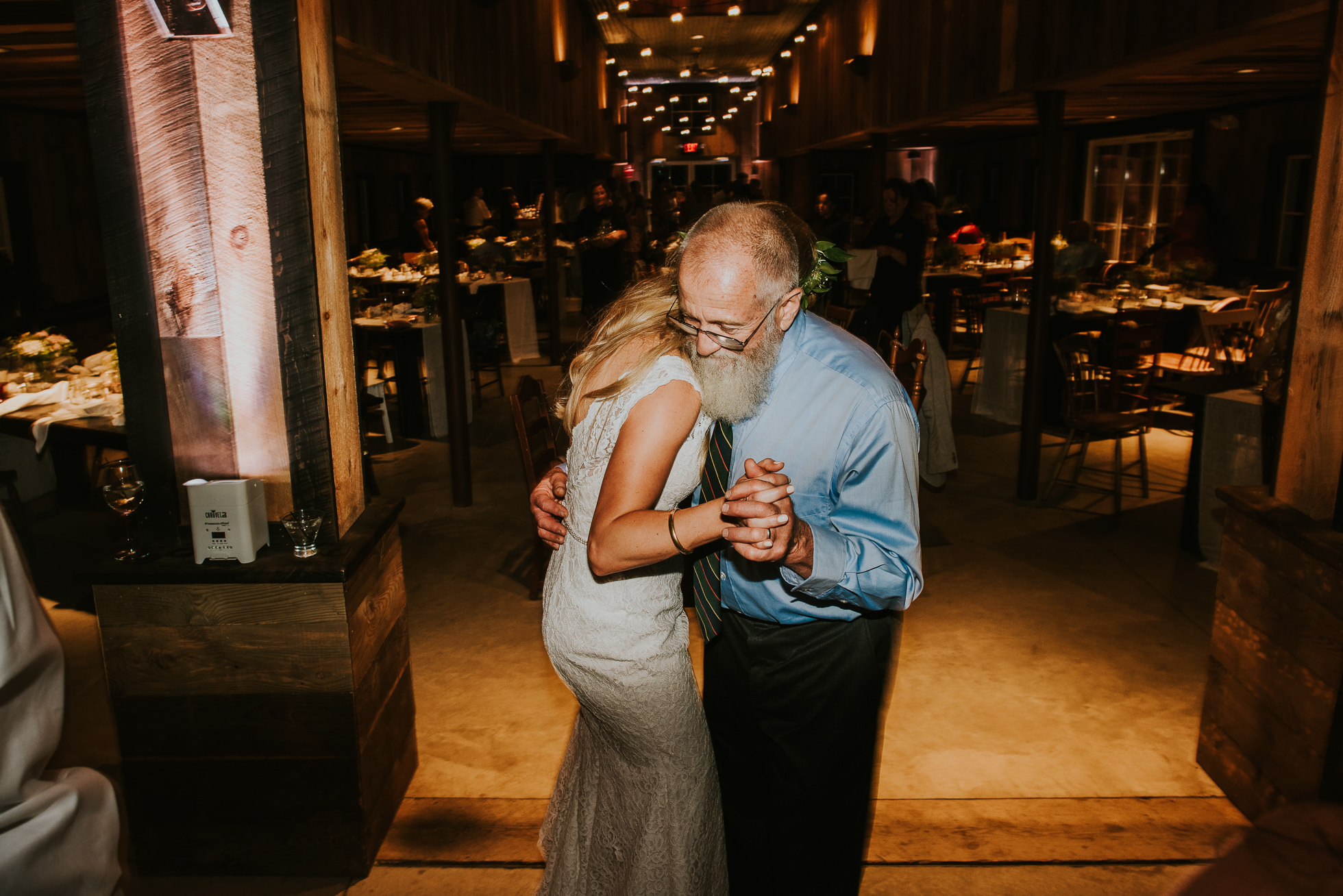 bride and father dance barn wedding photographed by Traverse the Tides