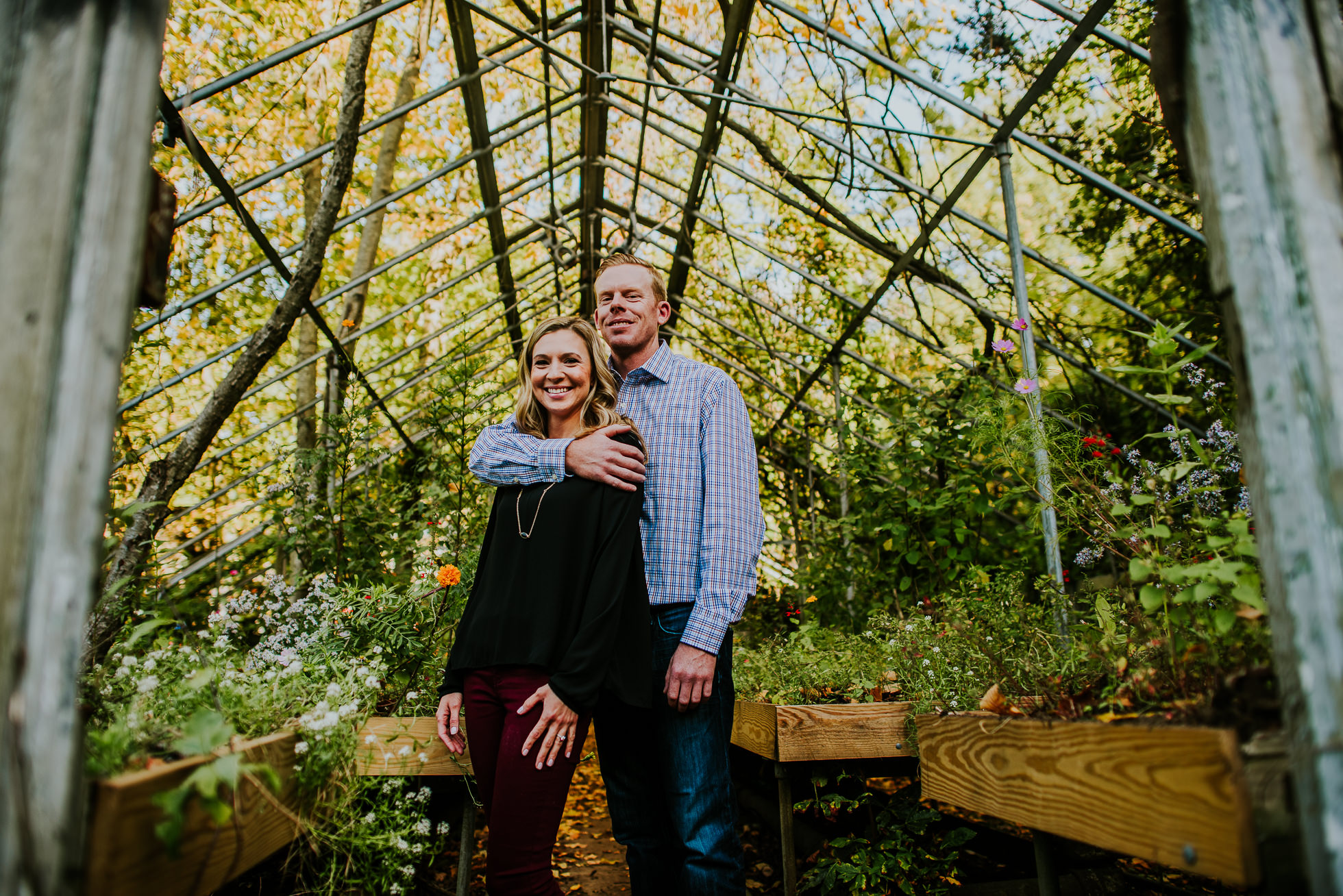 abandoned greenhouse engagement session photographed by Traverse the Tides