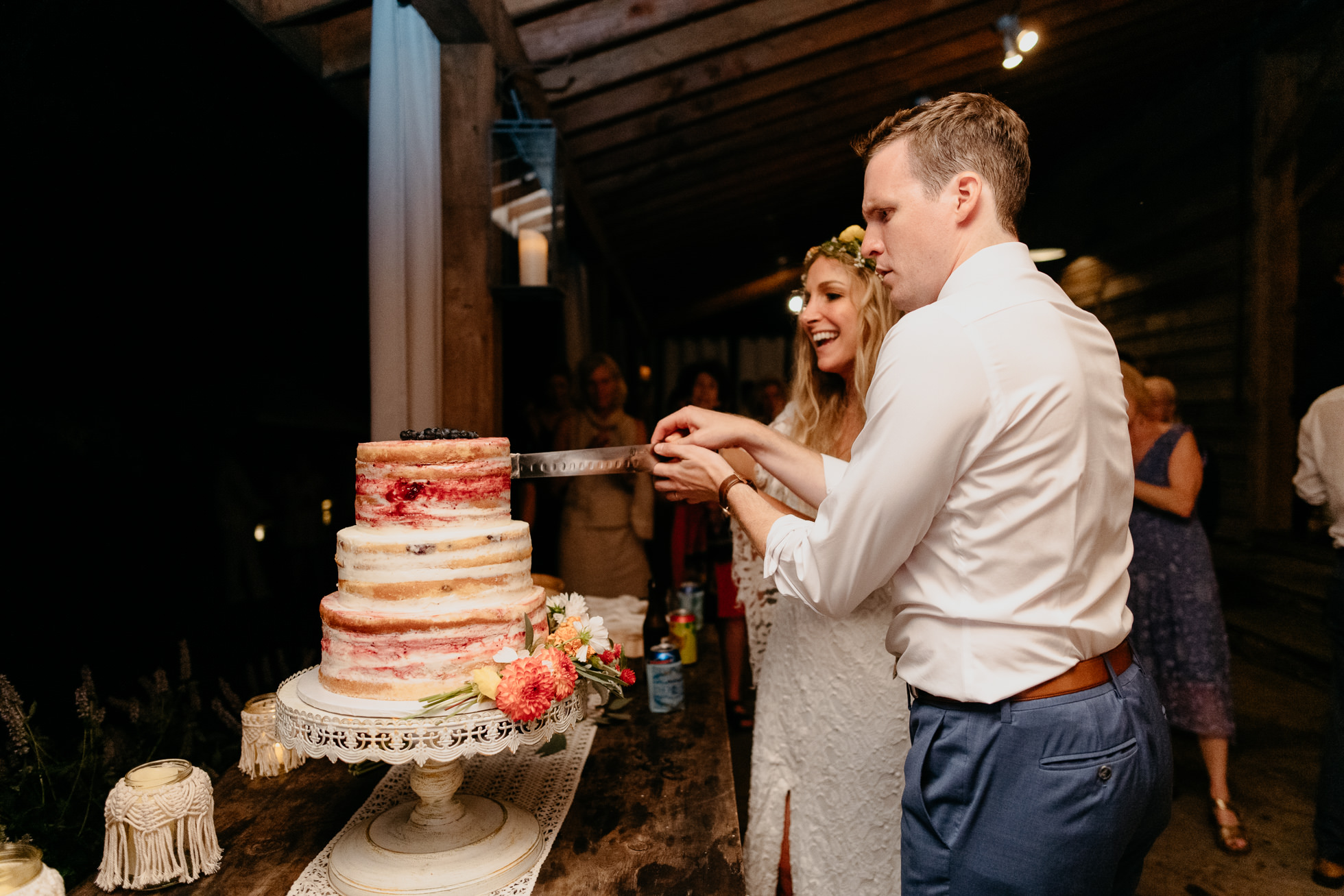 bride and groom cut the cake