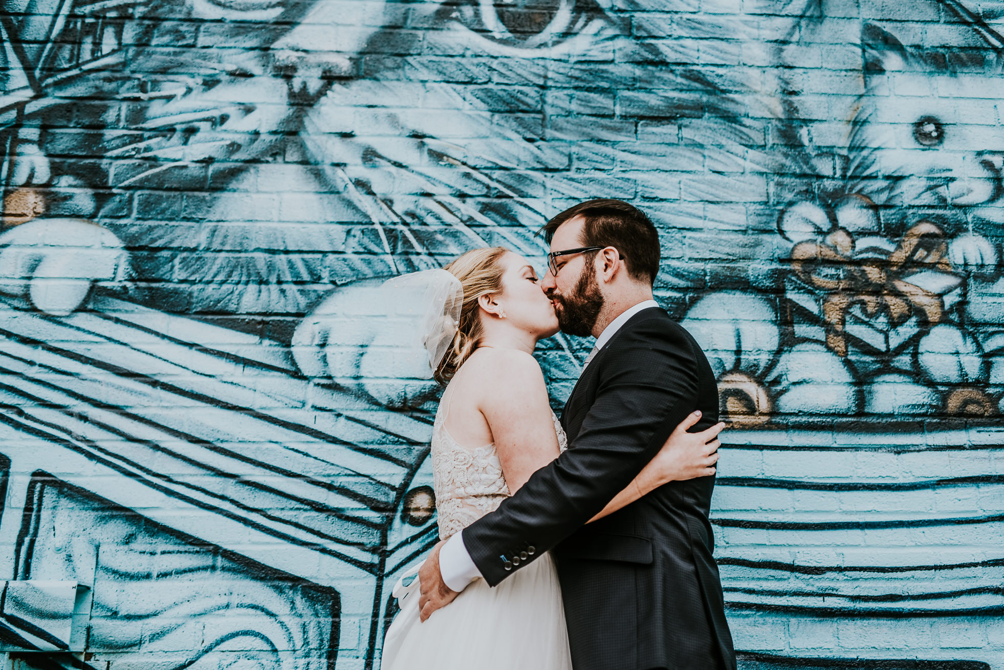 bride and groom kissing photographed by Traverse The Tides