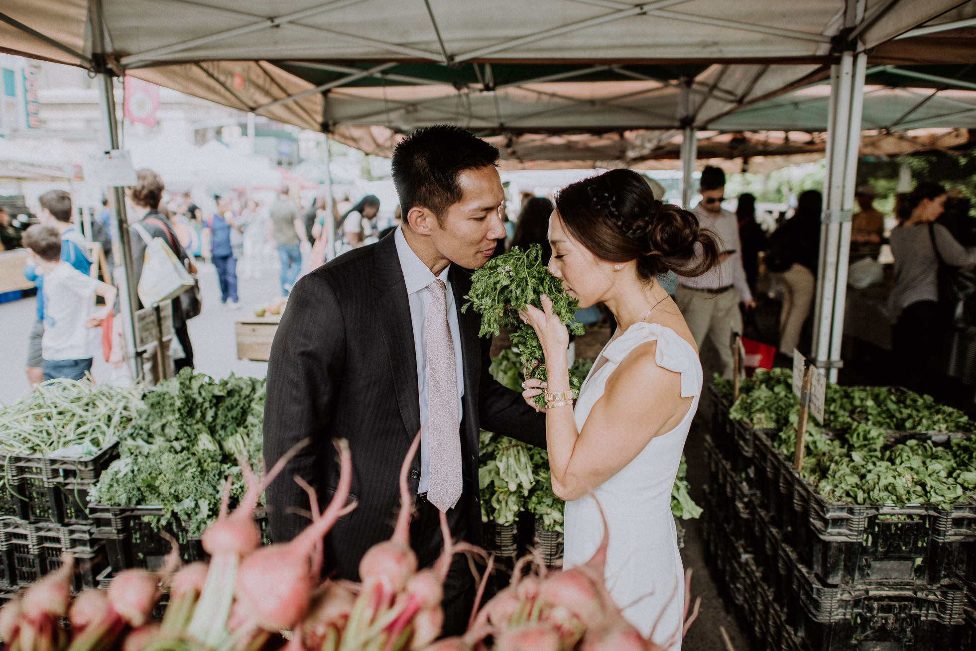 bride and groom shopping at market