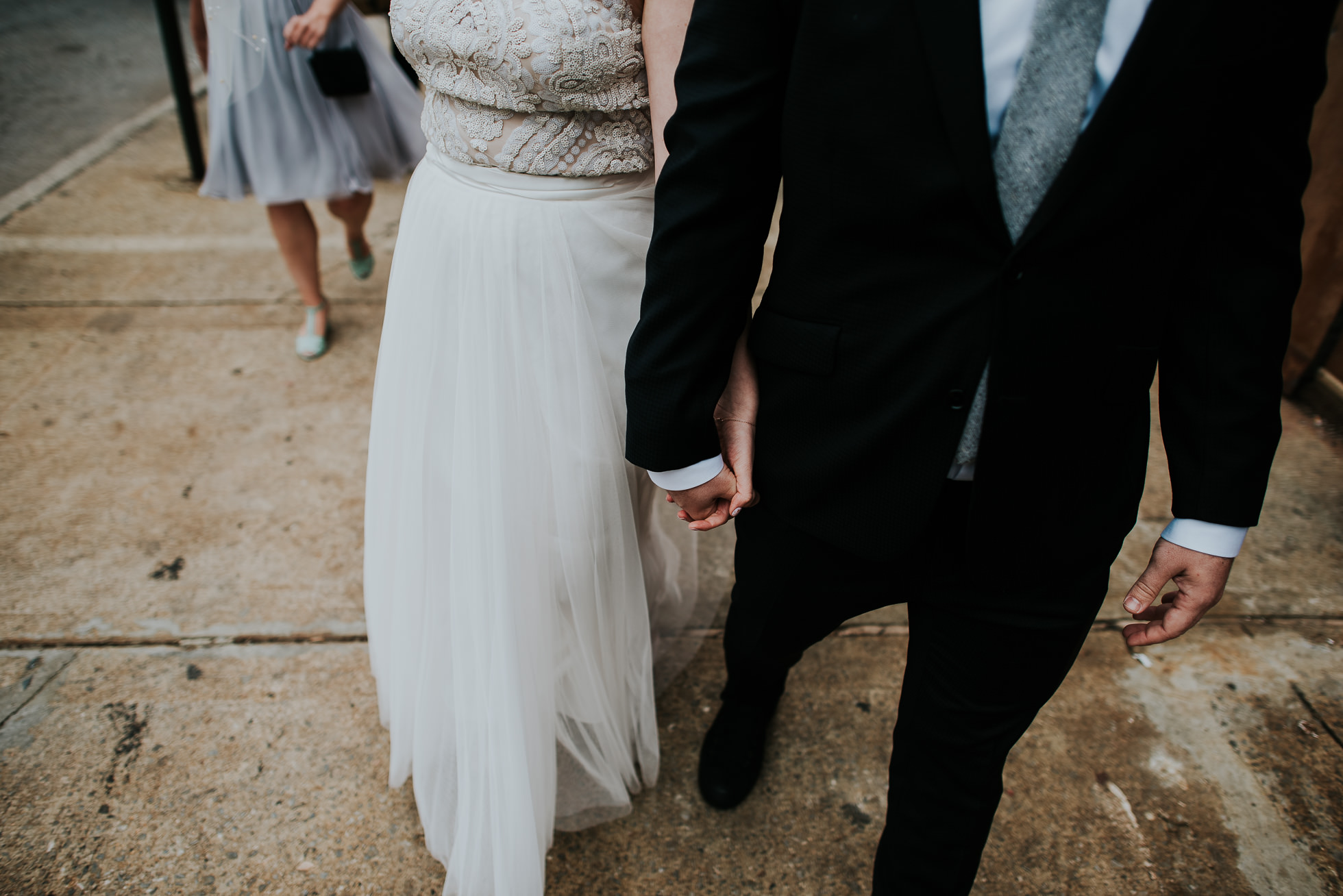 bride and groom walking photographed by Traverse The Tides