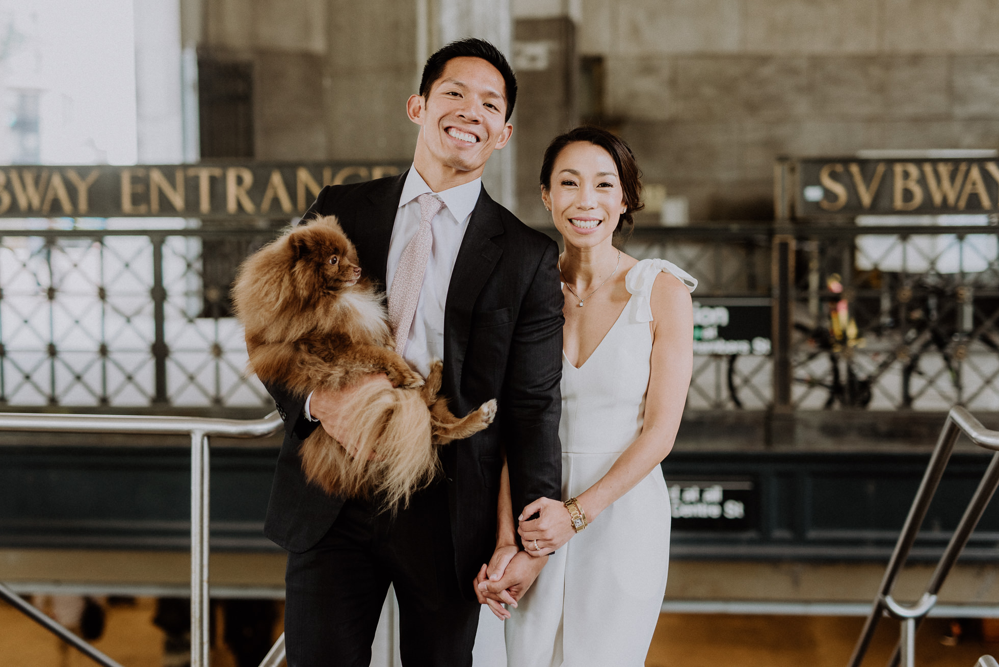 bride and groom with dog in subway