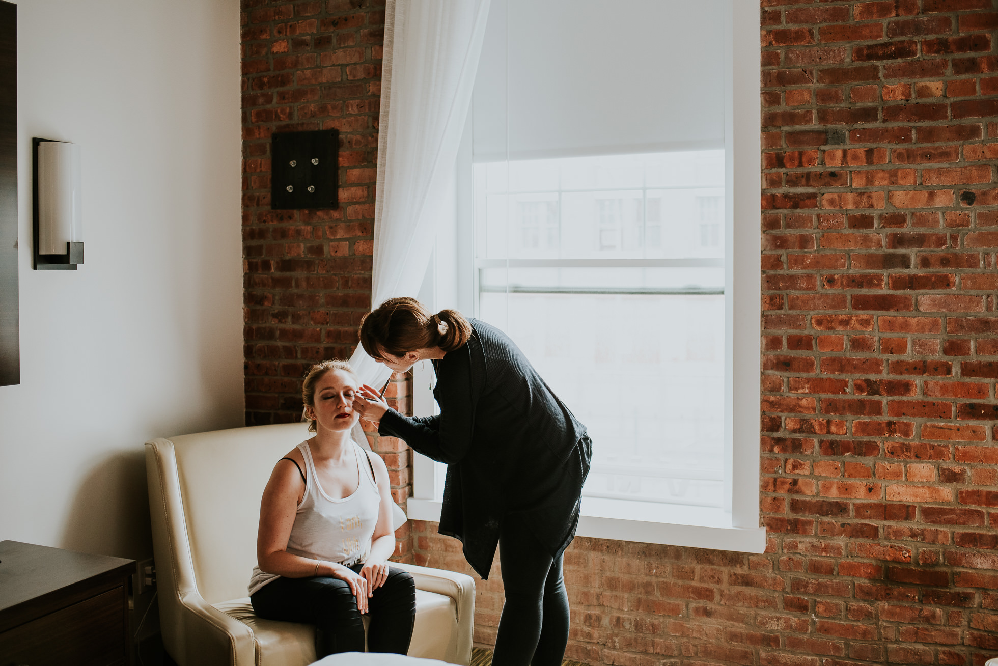 Bride getting makeup photographed by Traverse The Tides