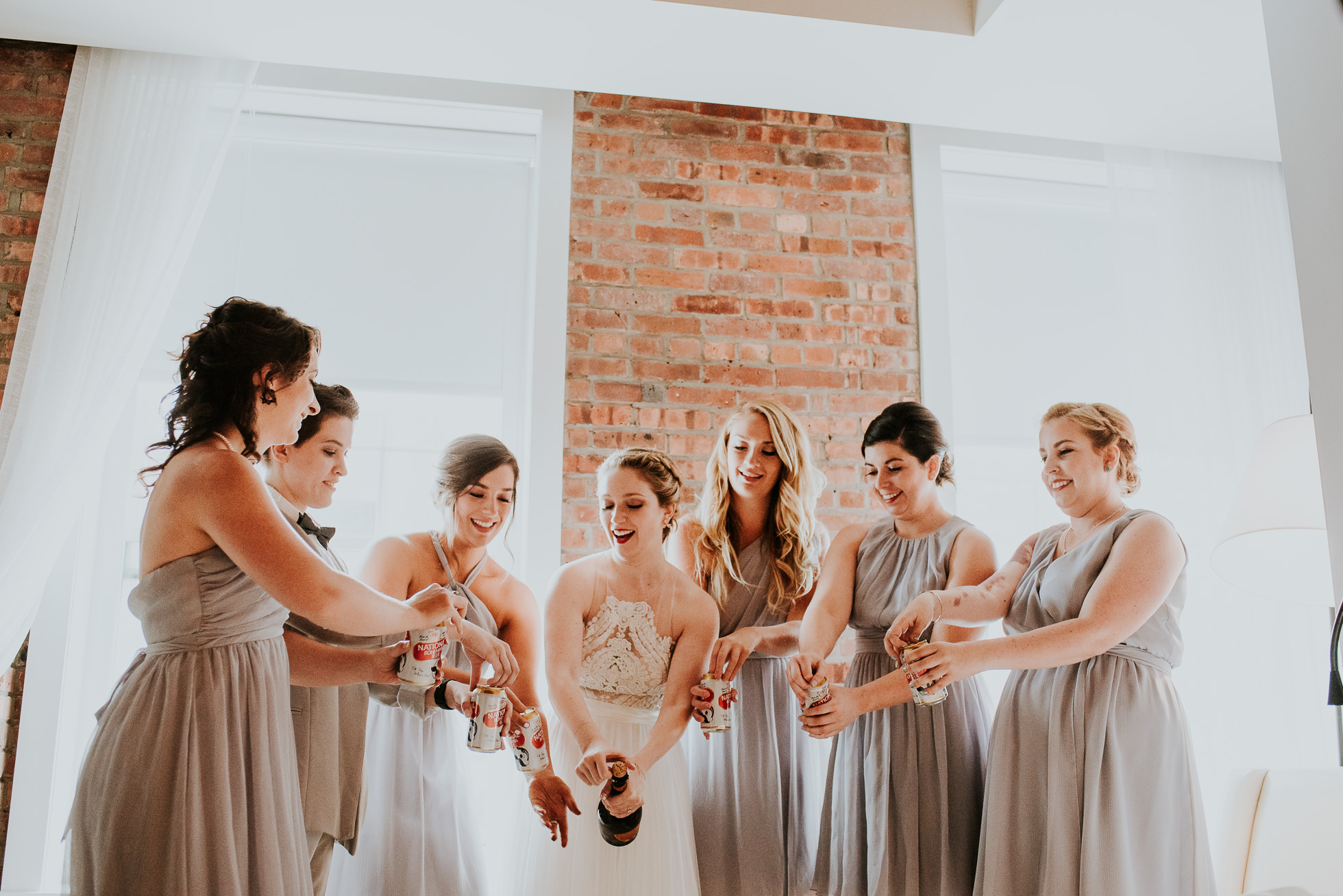 bridesmaids champagne photographed by Traverse The Tides