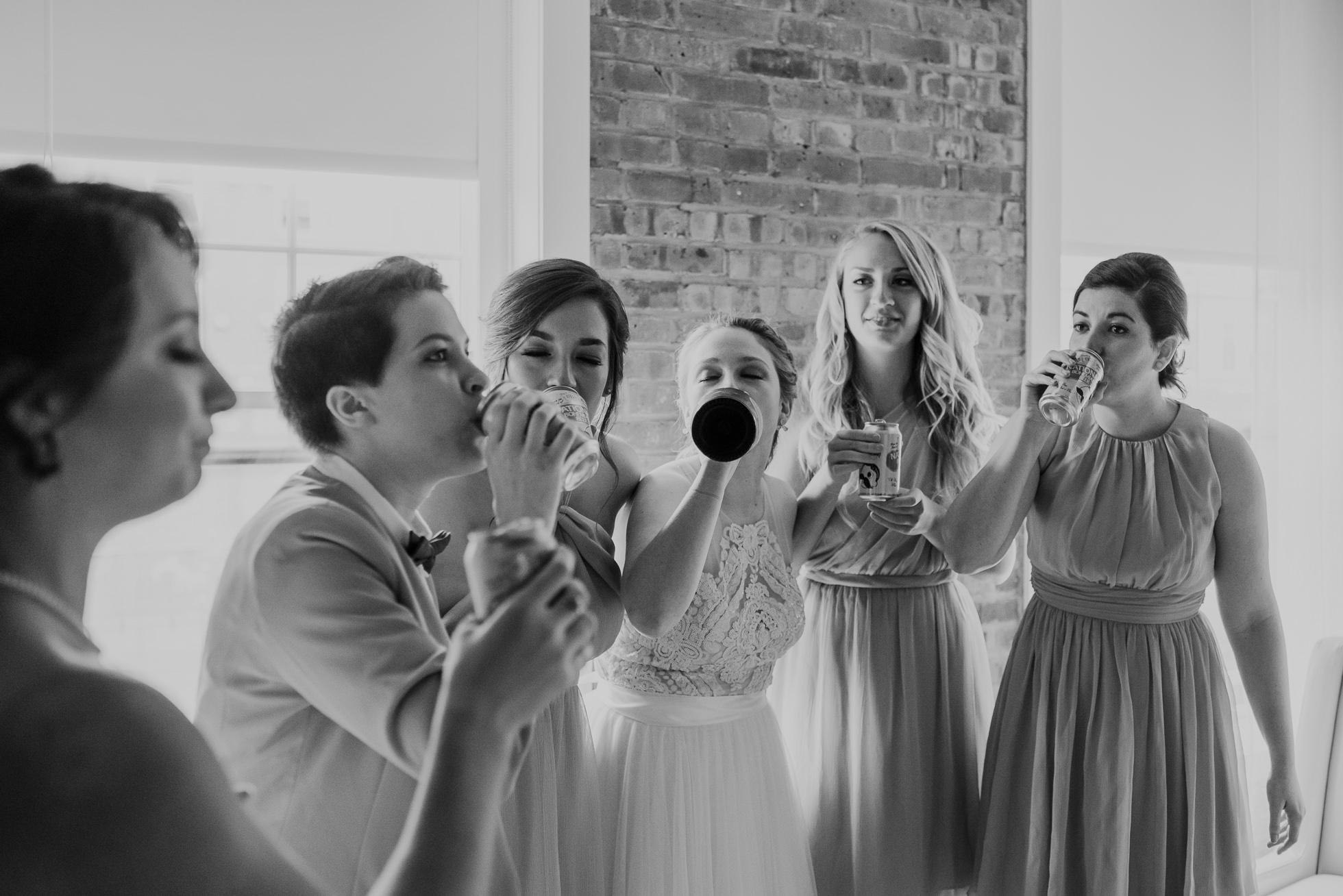 bridesmaids doing shots photographed by Traverse The Tides