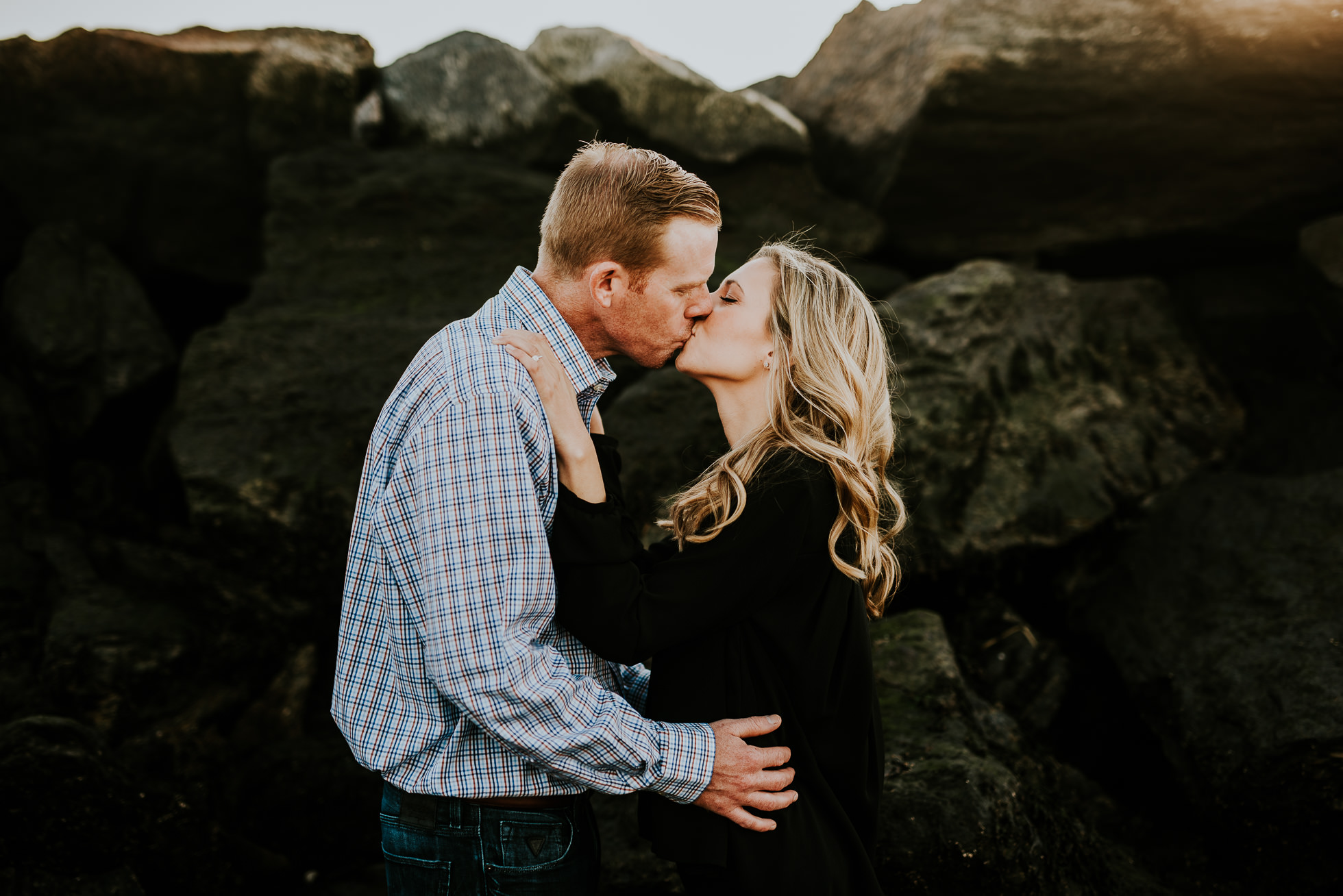 couple kissing engagement session photographed by Traverse the Tides
