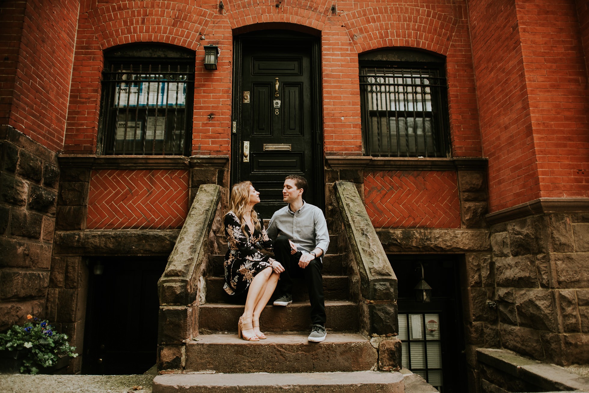 couple on stairs engagement photos photographed by Traverse the Tides36