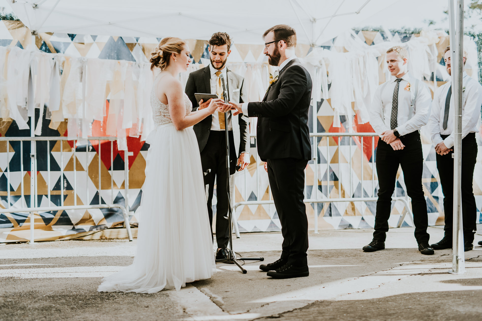 exchanging vows photographed by Traverse The Tides
