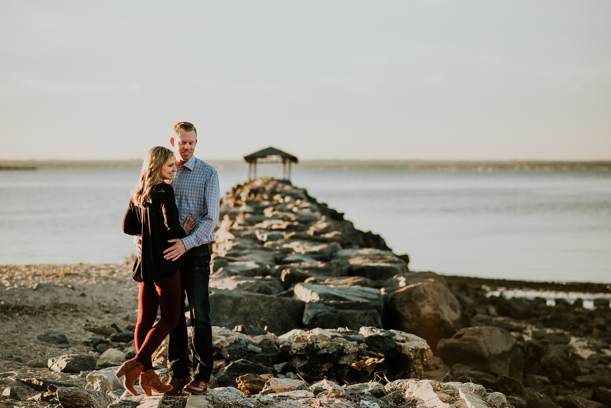 fishing pier engagement session photographed by Traverse the Tides