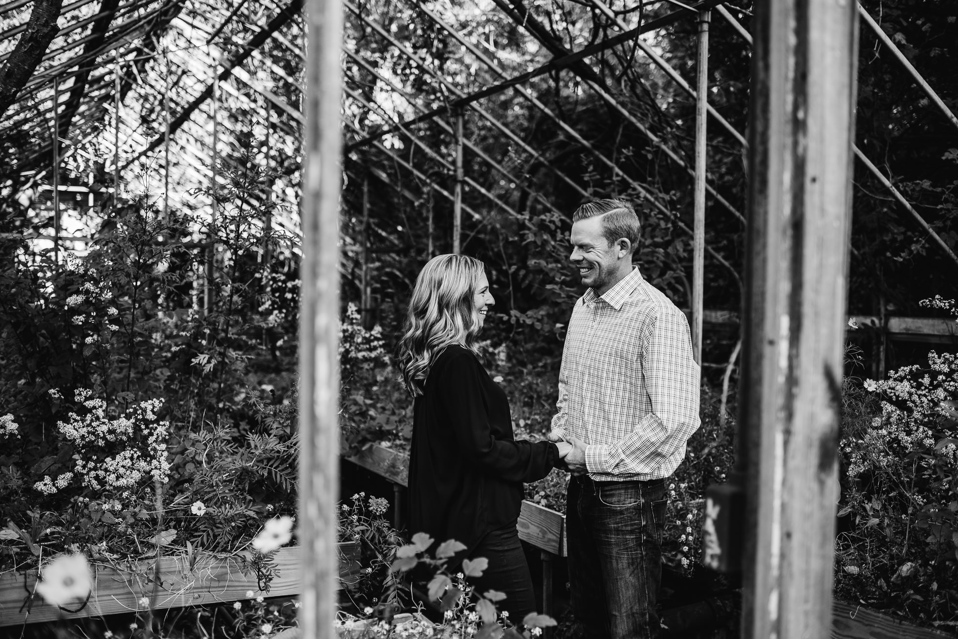 greenhouse engagement session photographed by Traverse the Tides