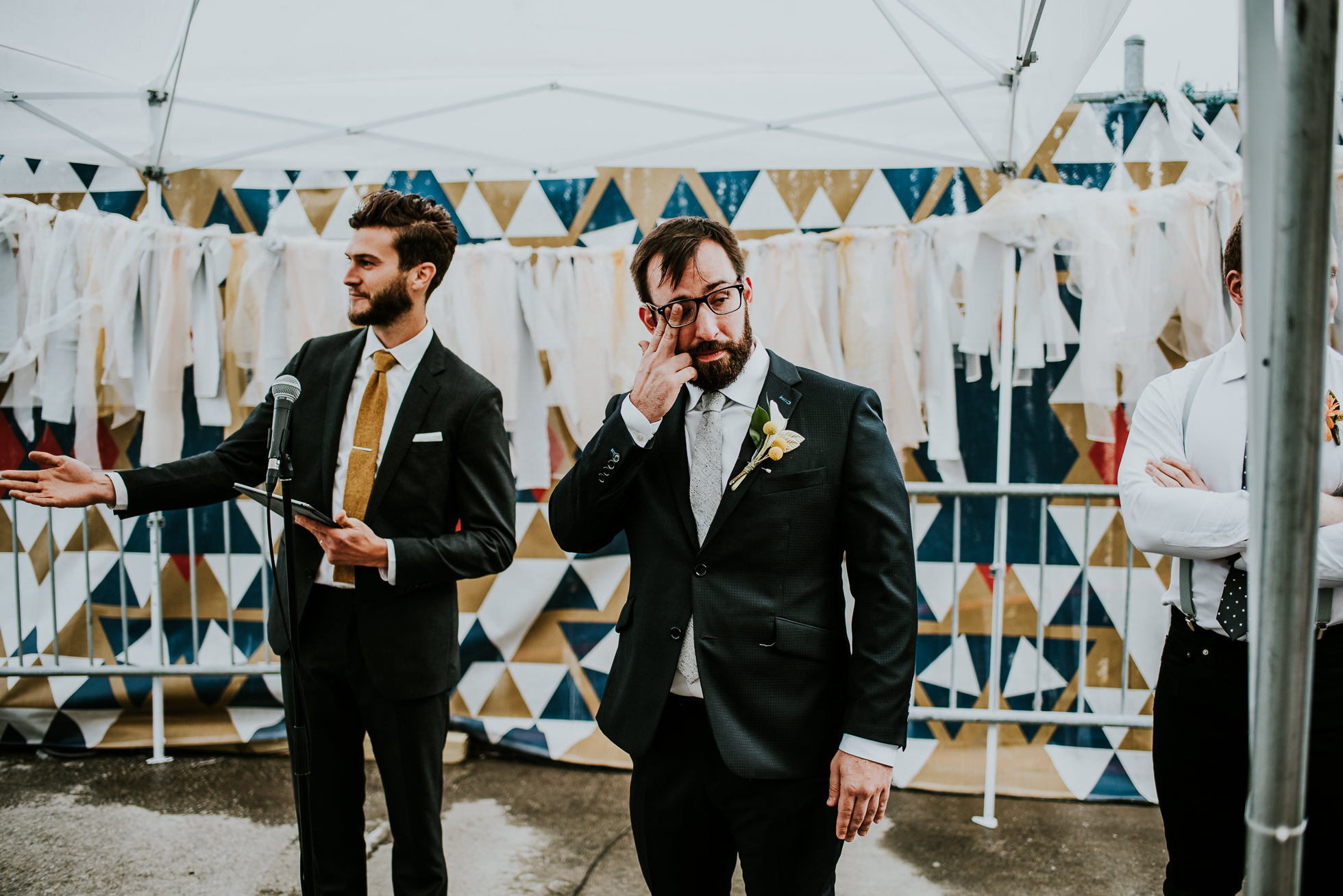 groom crying photographed by Traverse The Tides