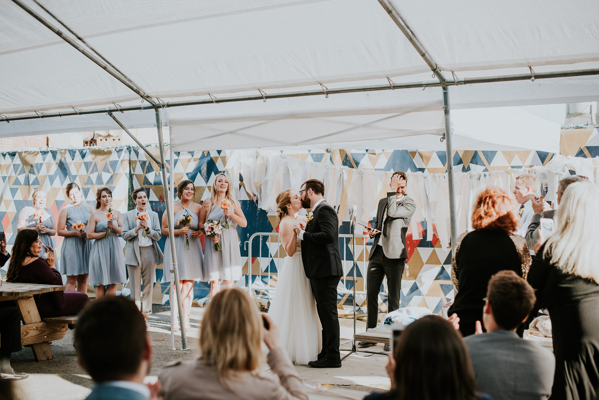 wedding first kiss photographed by Traverse the Tides