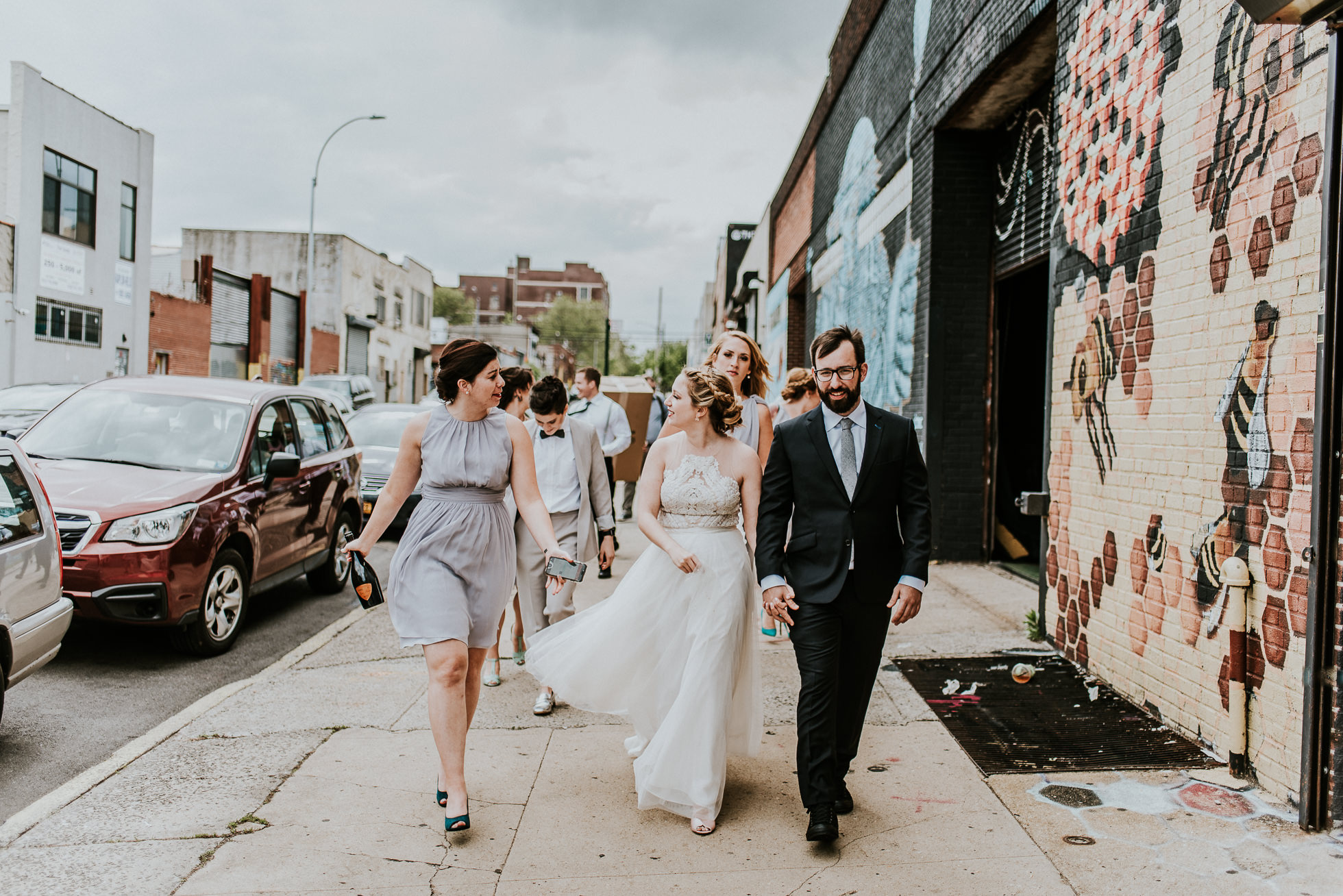 wedding party walking down street photographed by Traverse The Tides