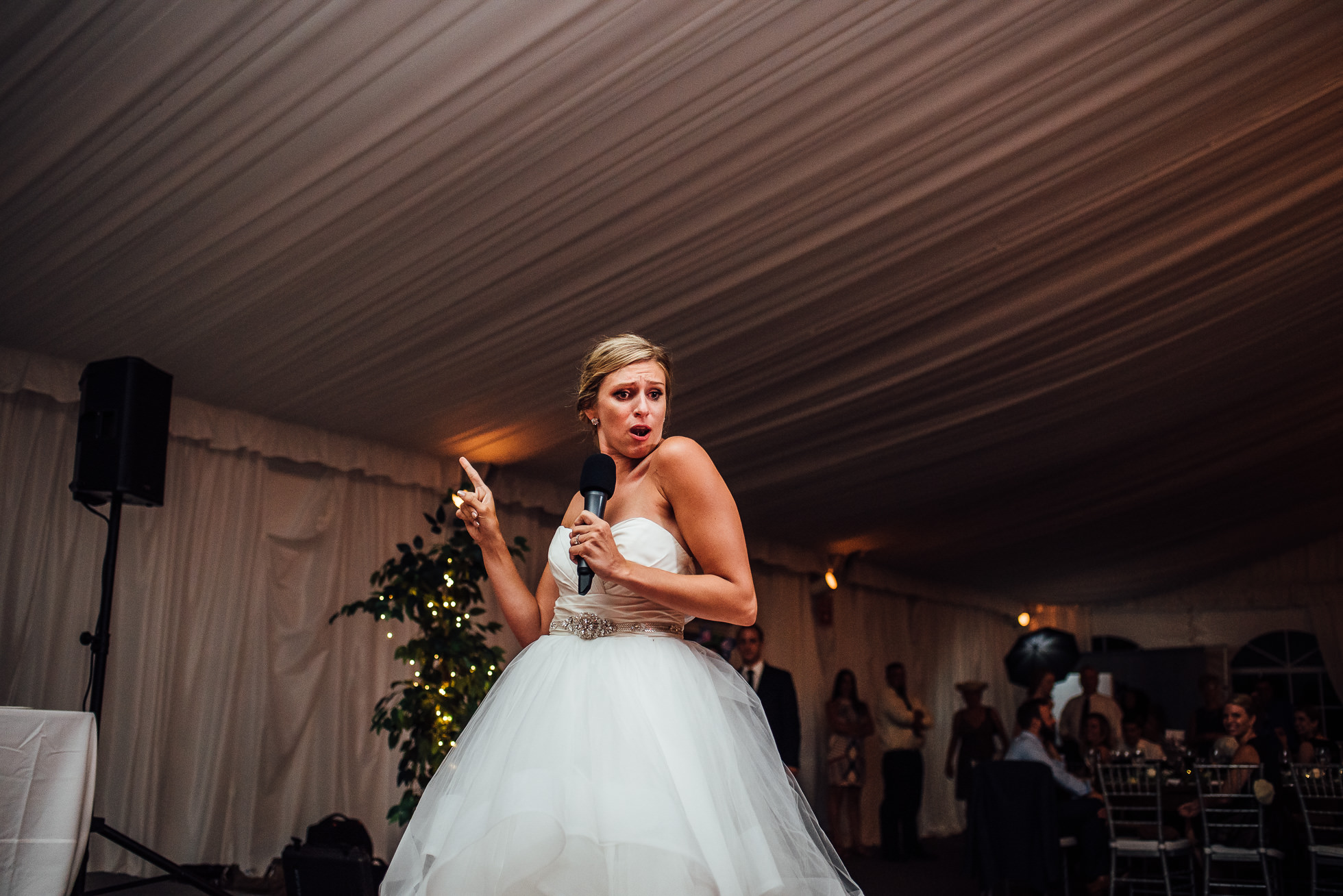 bride and groom sing at lyndhurst castle wedding photographed by traverse the tides