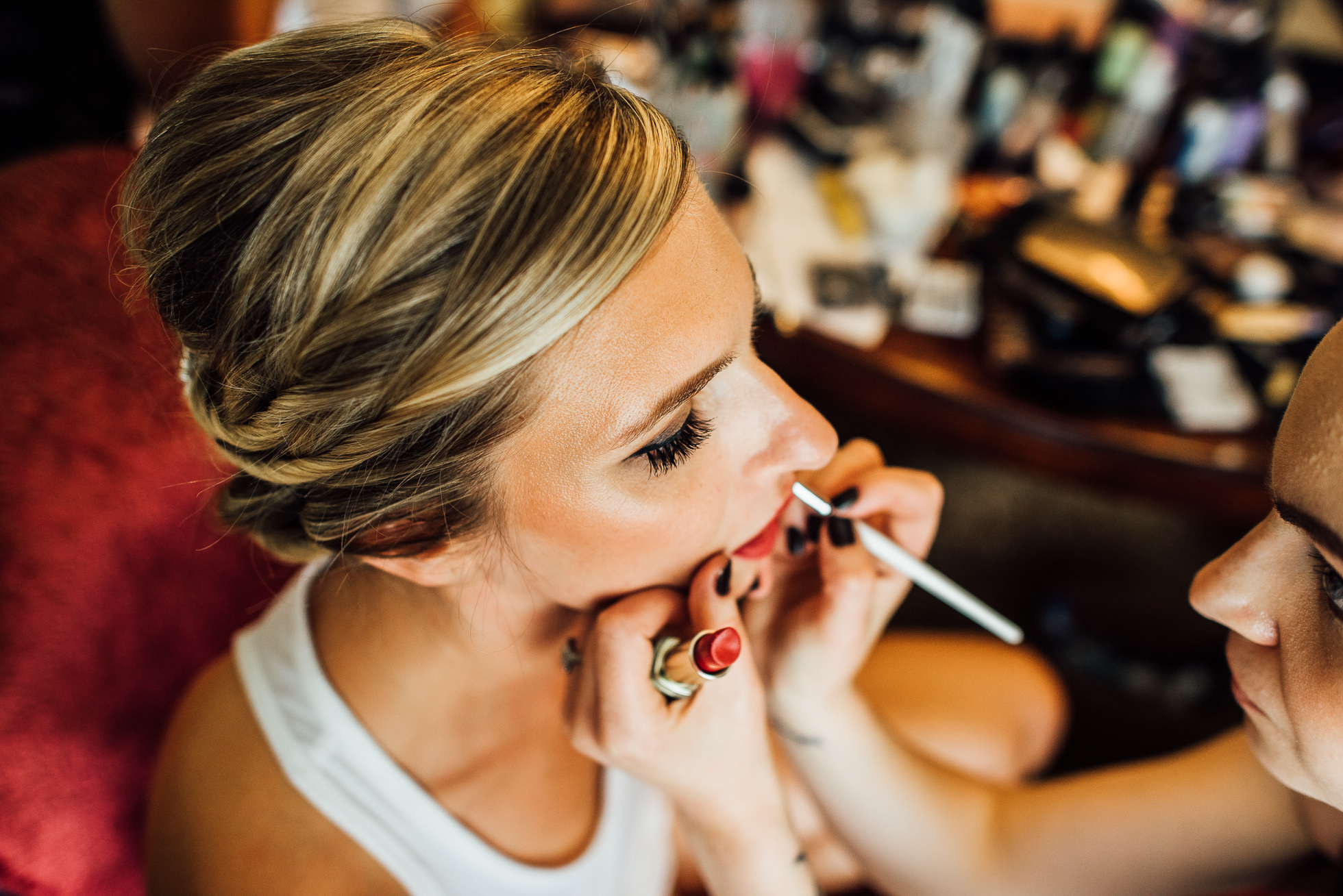 bride getting makeup done at lyndhurst castle wedding photographed by traverse the tides-2