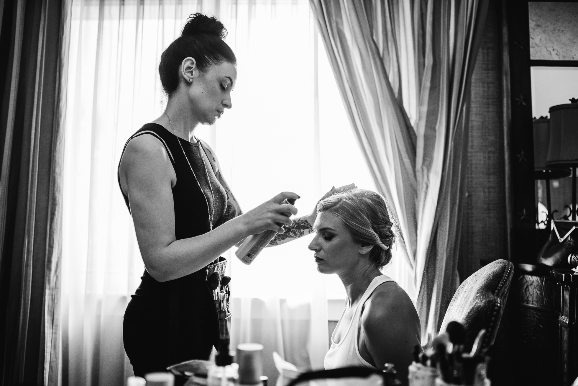 bride getting makeup done at lyndhurst castle wedding photographed by traverse the tides-3