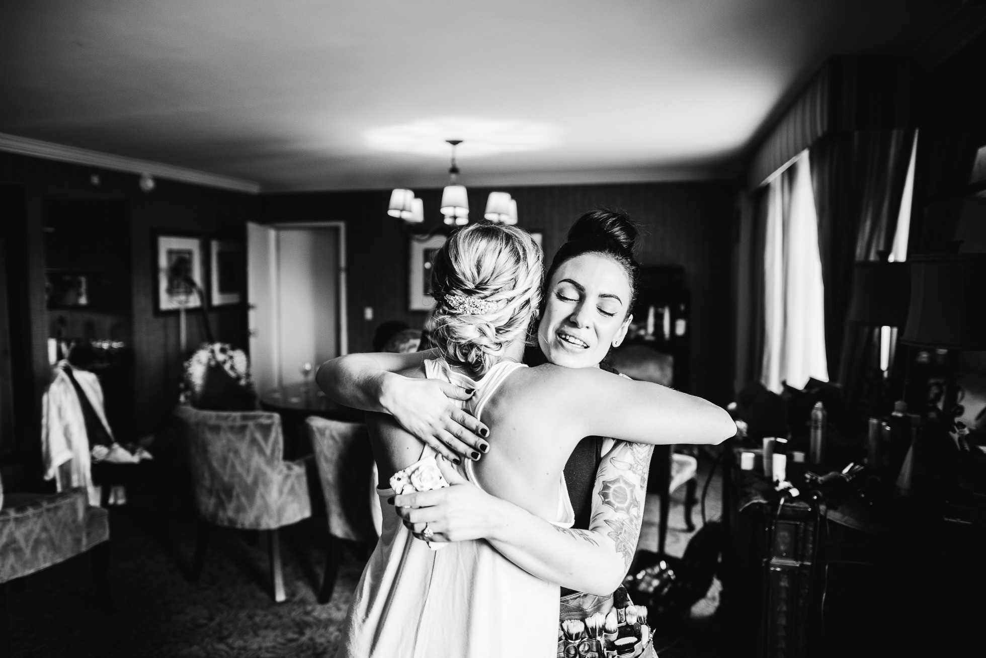 bride hugging at lyndhurst castle wedding photographed by traverse the tides