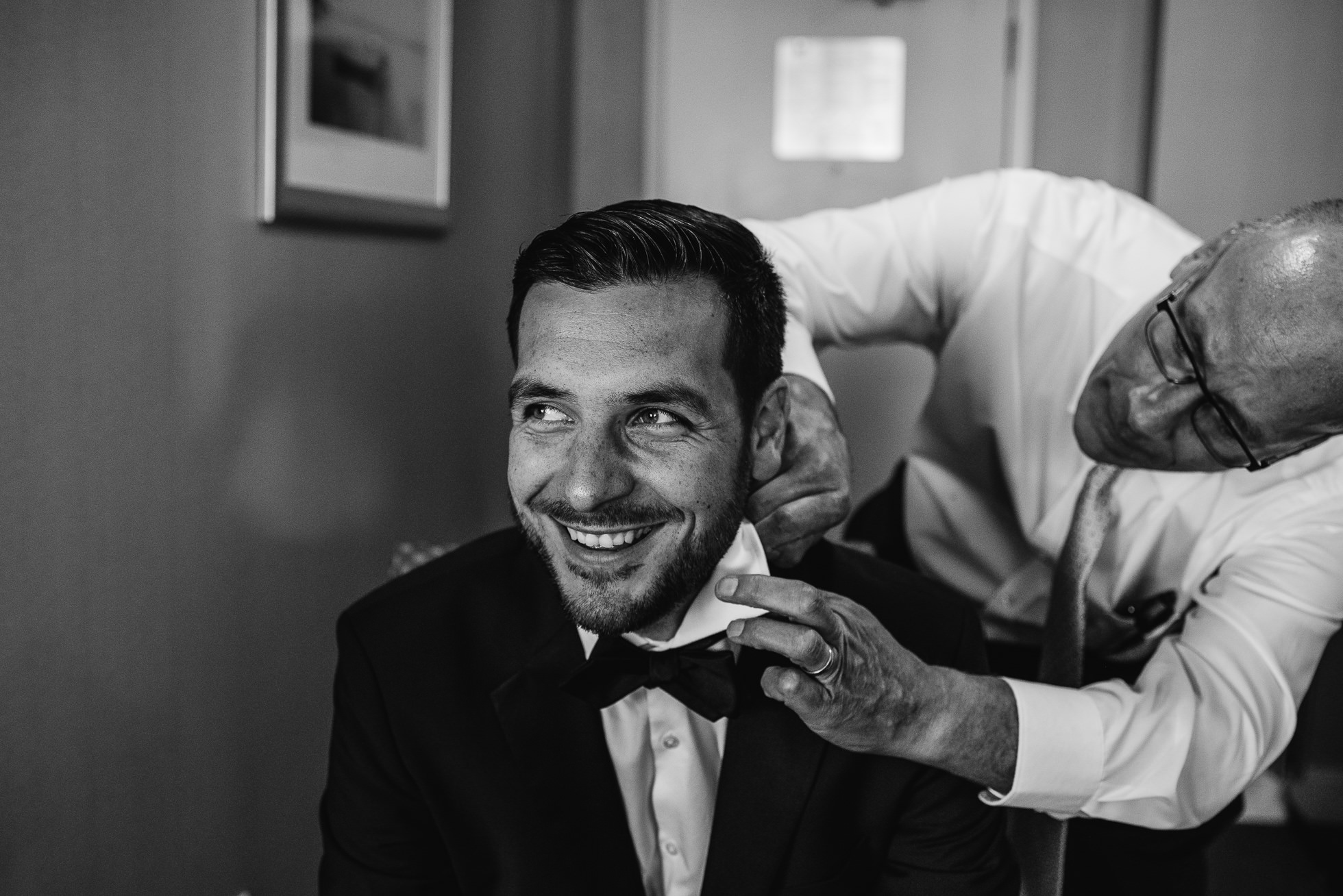groom and father at lyndhurst castle wedding photographed by traverse the tides