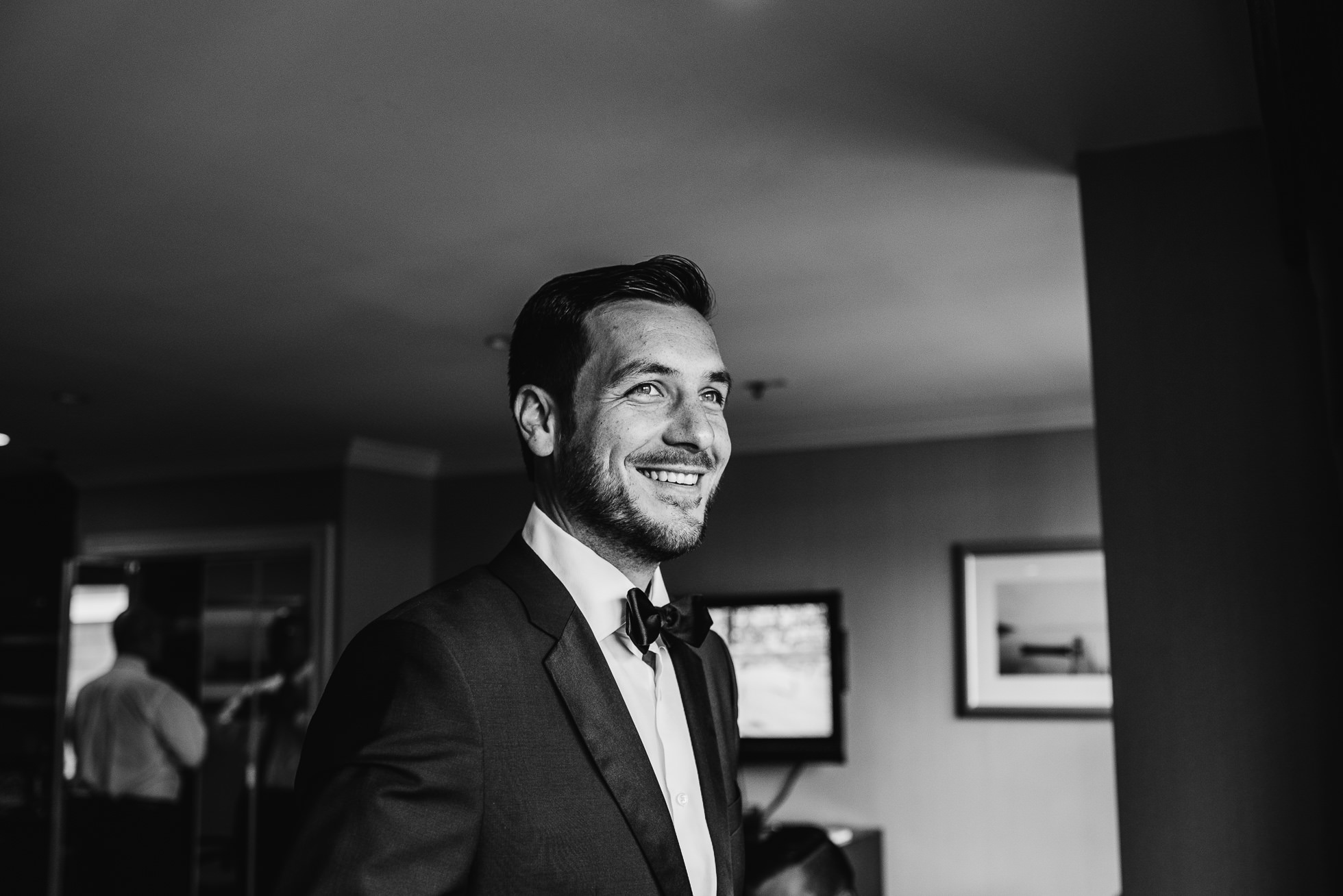 groom getting ready at lyndhurst castle wedding photographed by traverse the tides