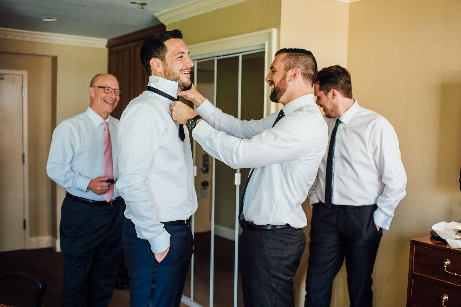 groom getting ready with groomsmen lyndhurst castle wedding photographed by traverse the tides