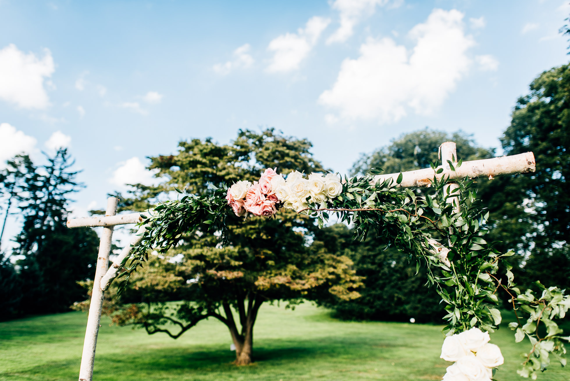 wedding ceremony altar on lawn at lyndhurst castle photographed by traverse the tides
