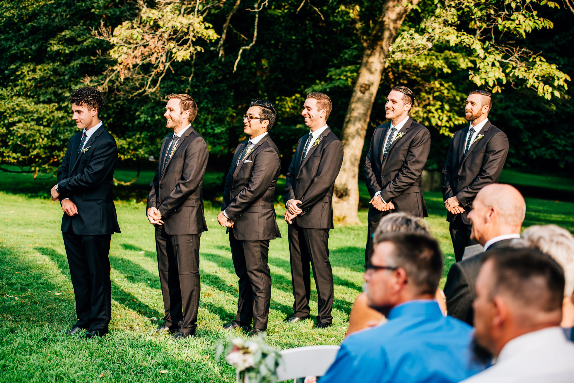 wedding ceremony groomsmen at lyndhurst castle photographed by traverse the tides
