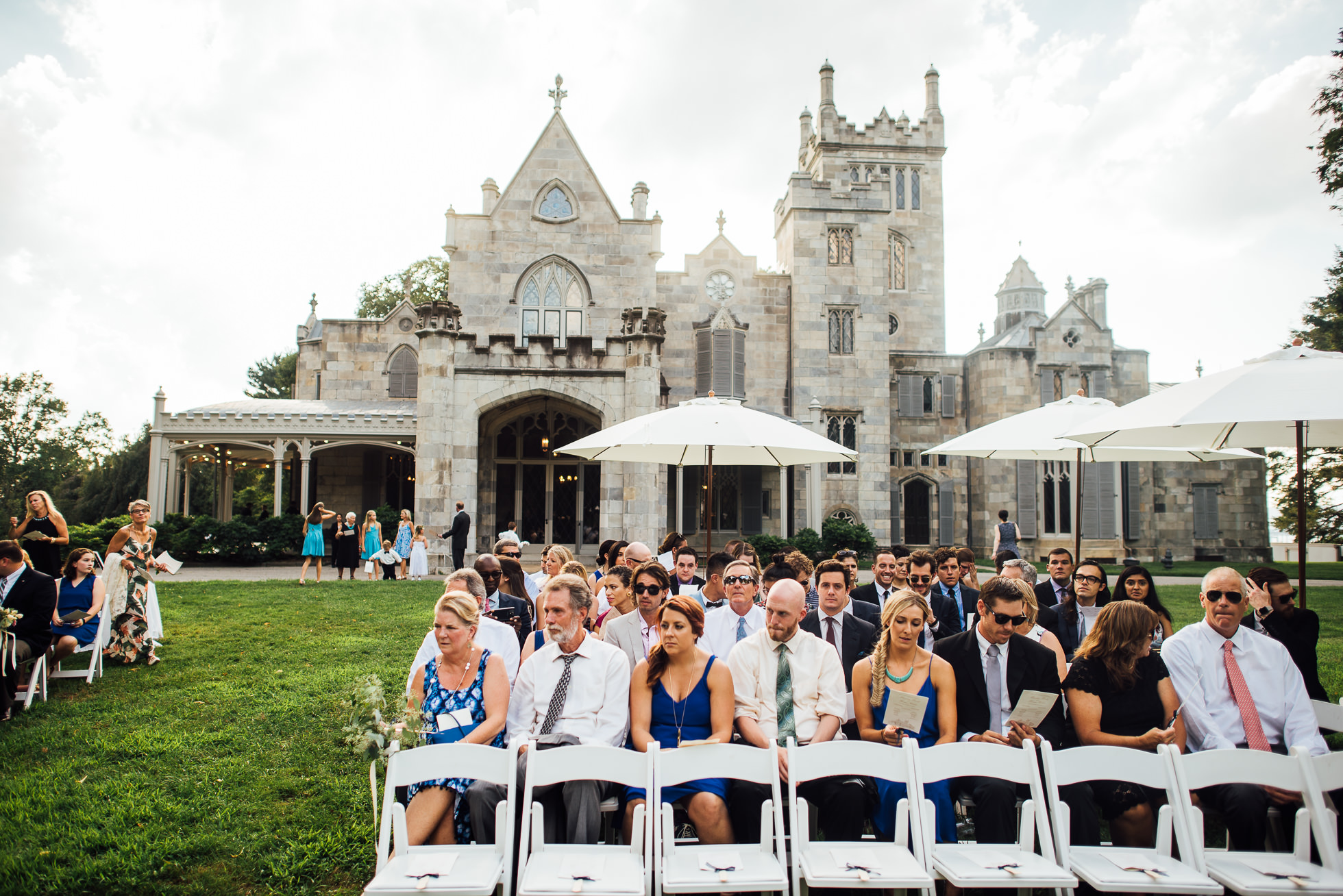 wedding ceremony on lawn at lyndhurst castle photographed by traverse the tides