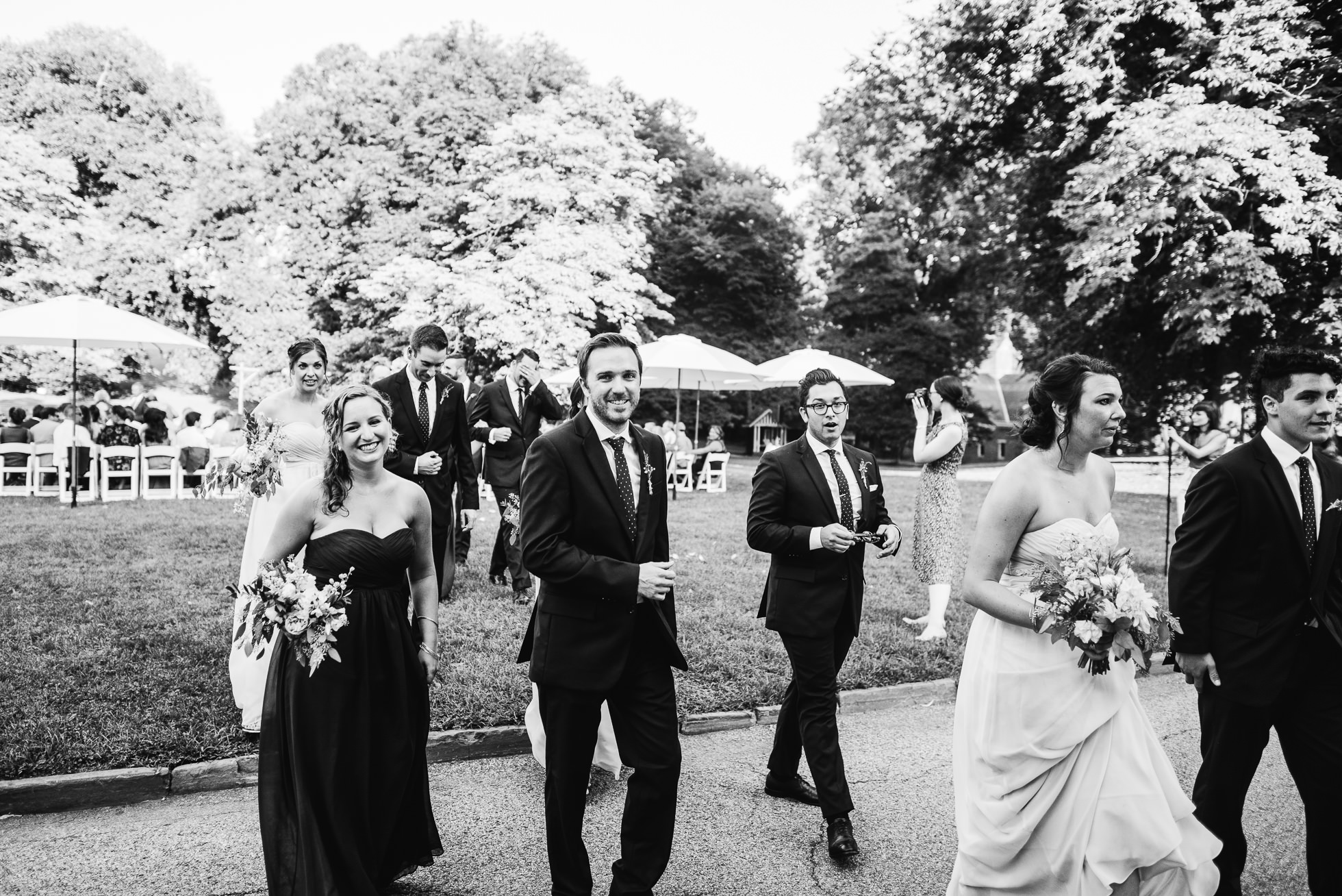 wedding party exit at wedding ceremony at lyndhurst castle photographed by traverse the tides