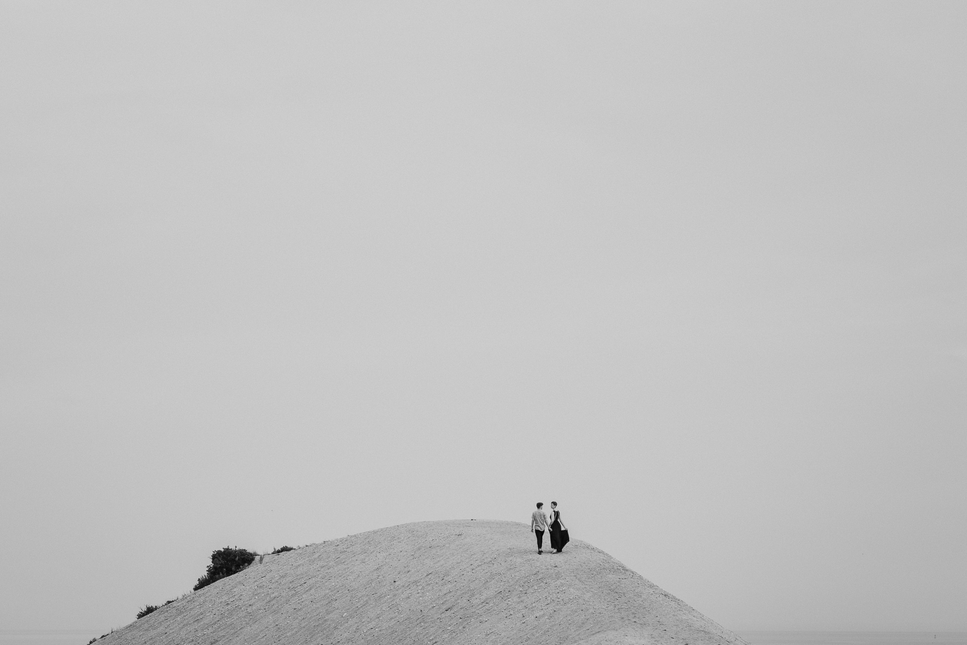 couple on a hill photographed by traverse the tides