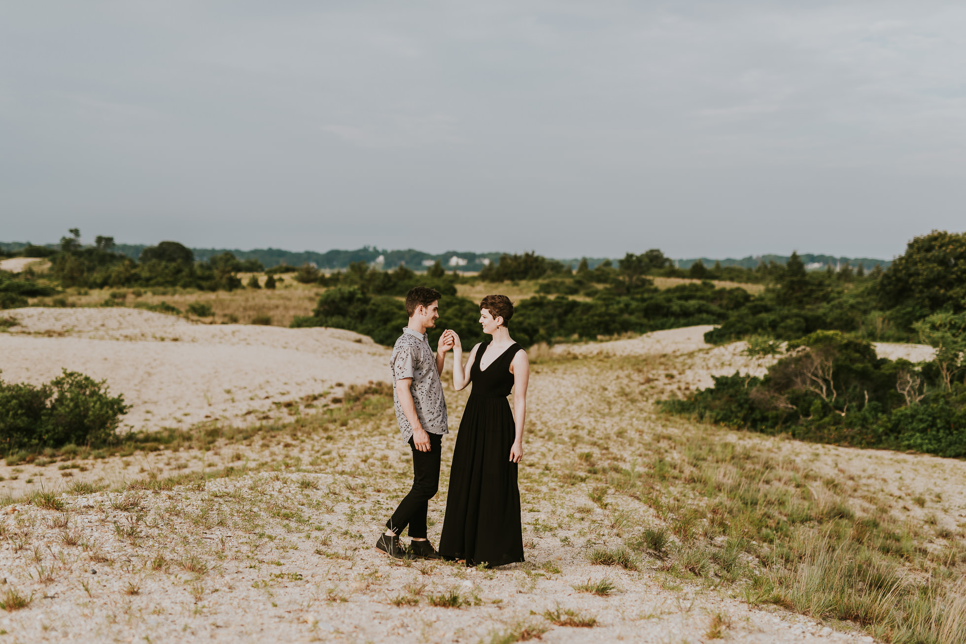black maxi dress engagement photos photographed by traverse the tides