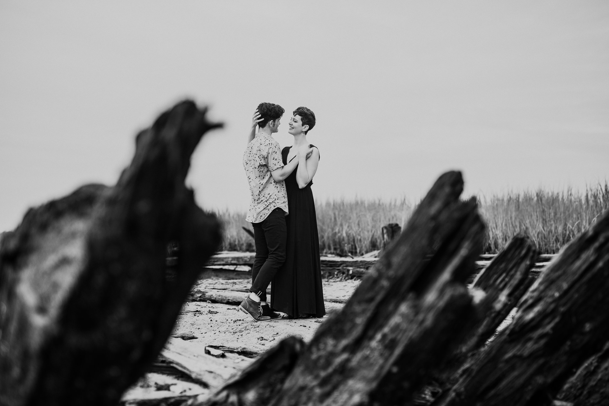 fishing dock engagement photographed by traverse the tides
