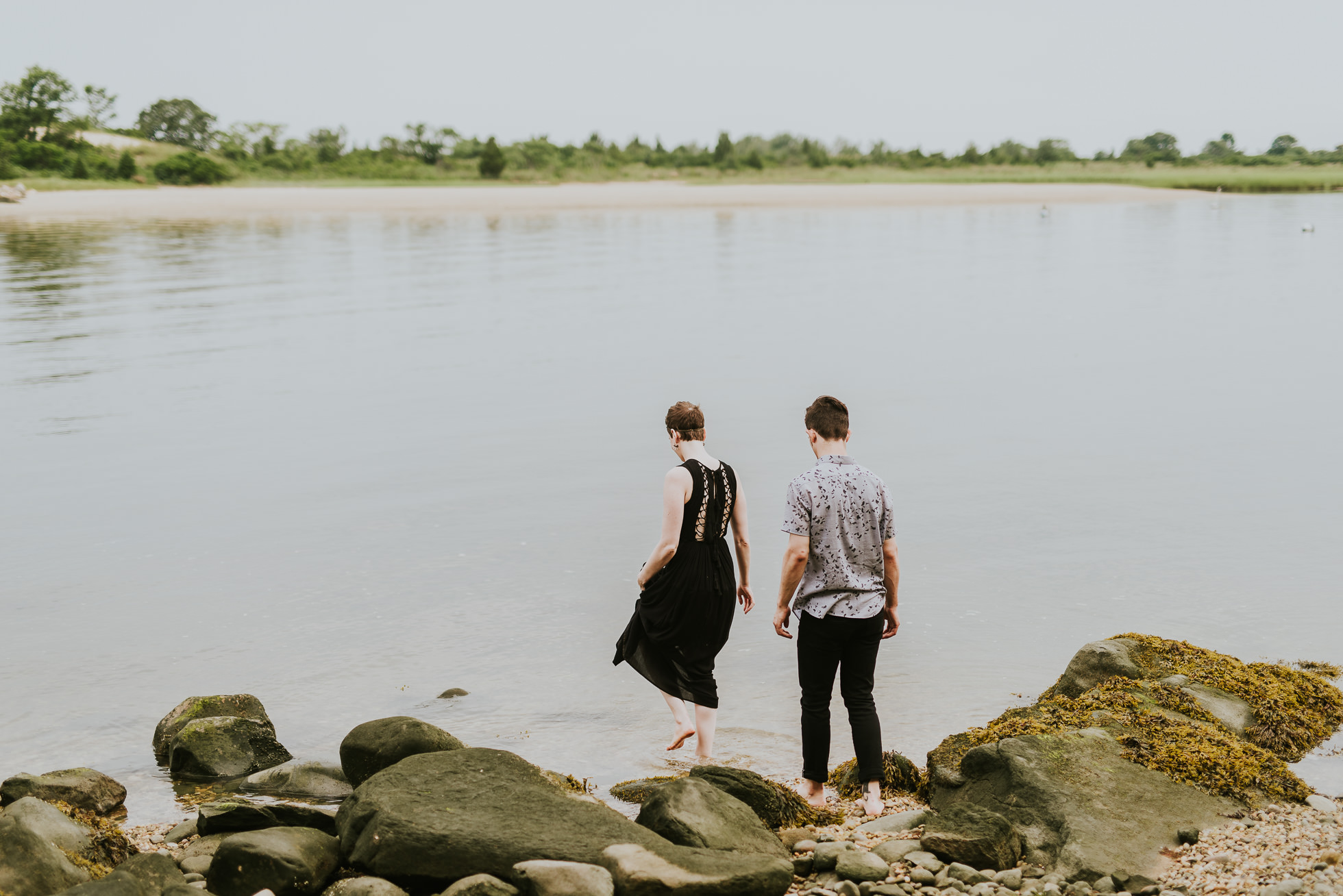 couple in water engagement photographed by traverse the tides