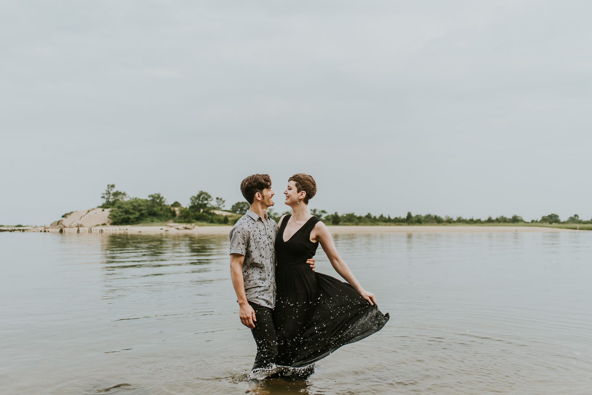 engagement session in water photographed by traverse the tides