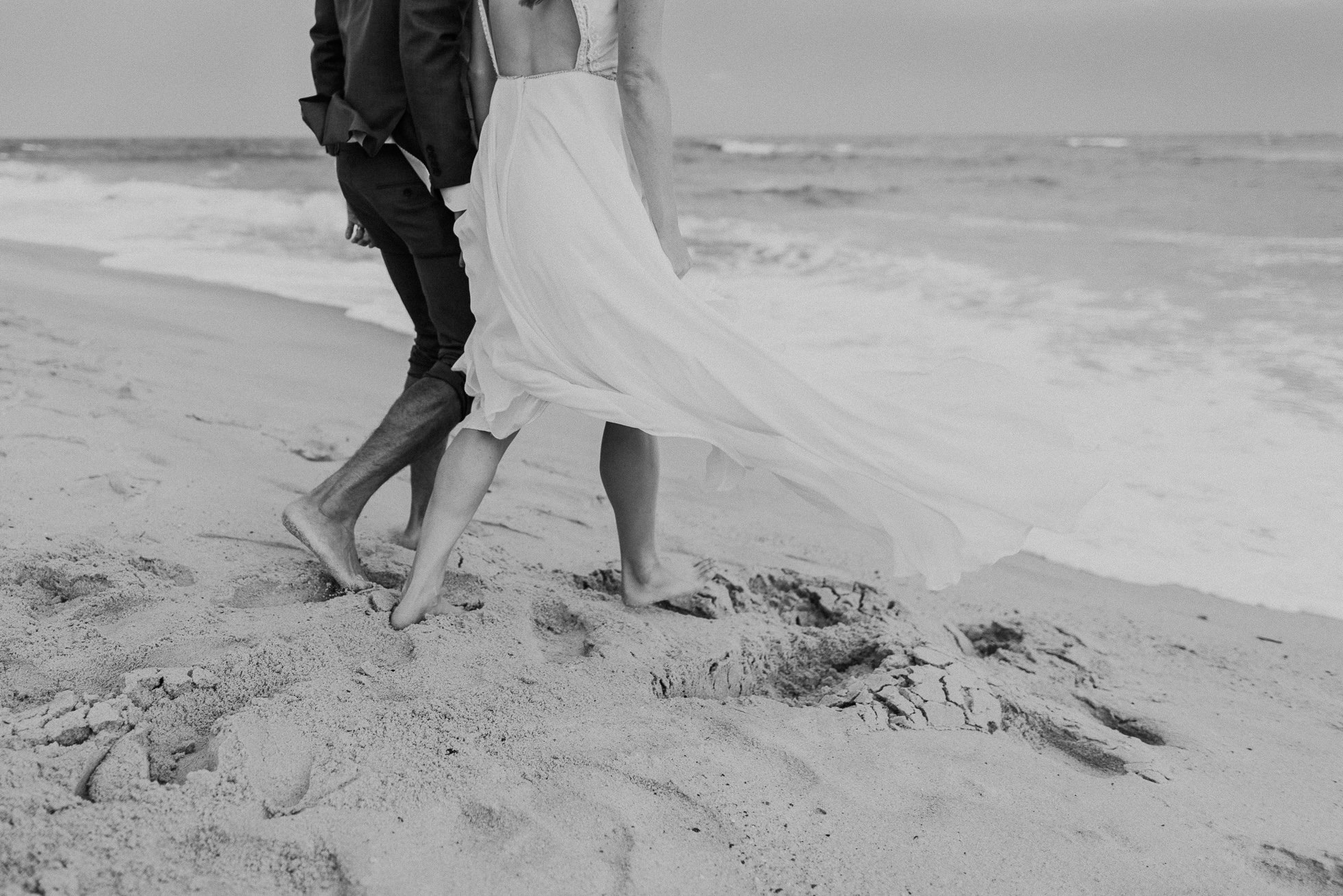 bride and groom walking at beach Montauk wedding photographed by Traverse the Tides