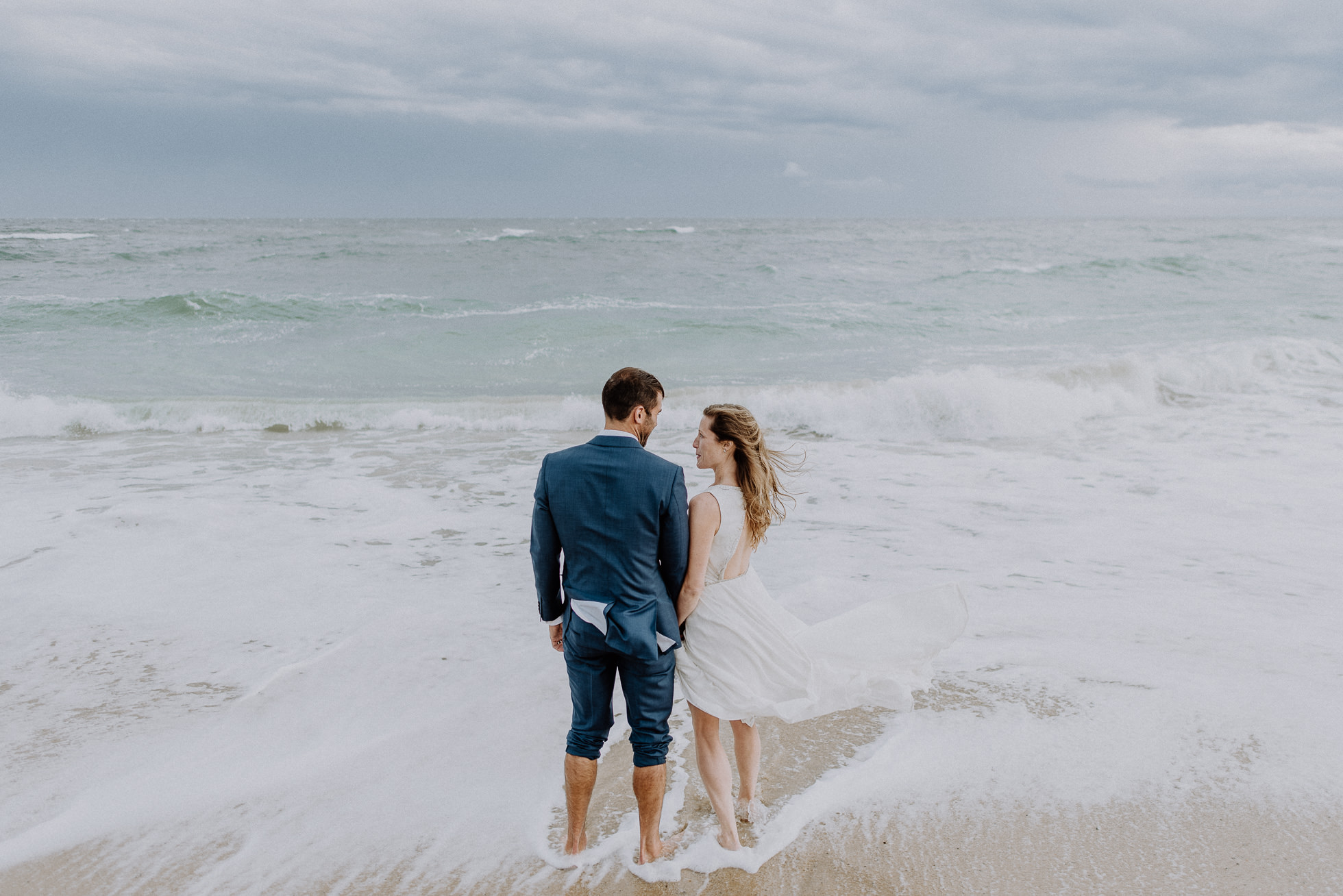 bride and groom going in the ocean Montauk wedding photographed by Traverse the Tides