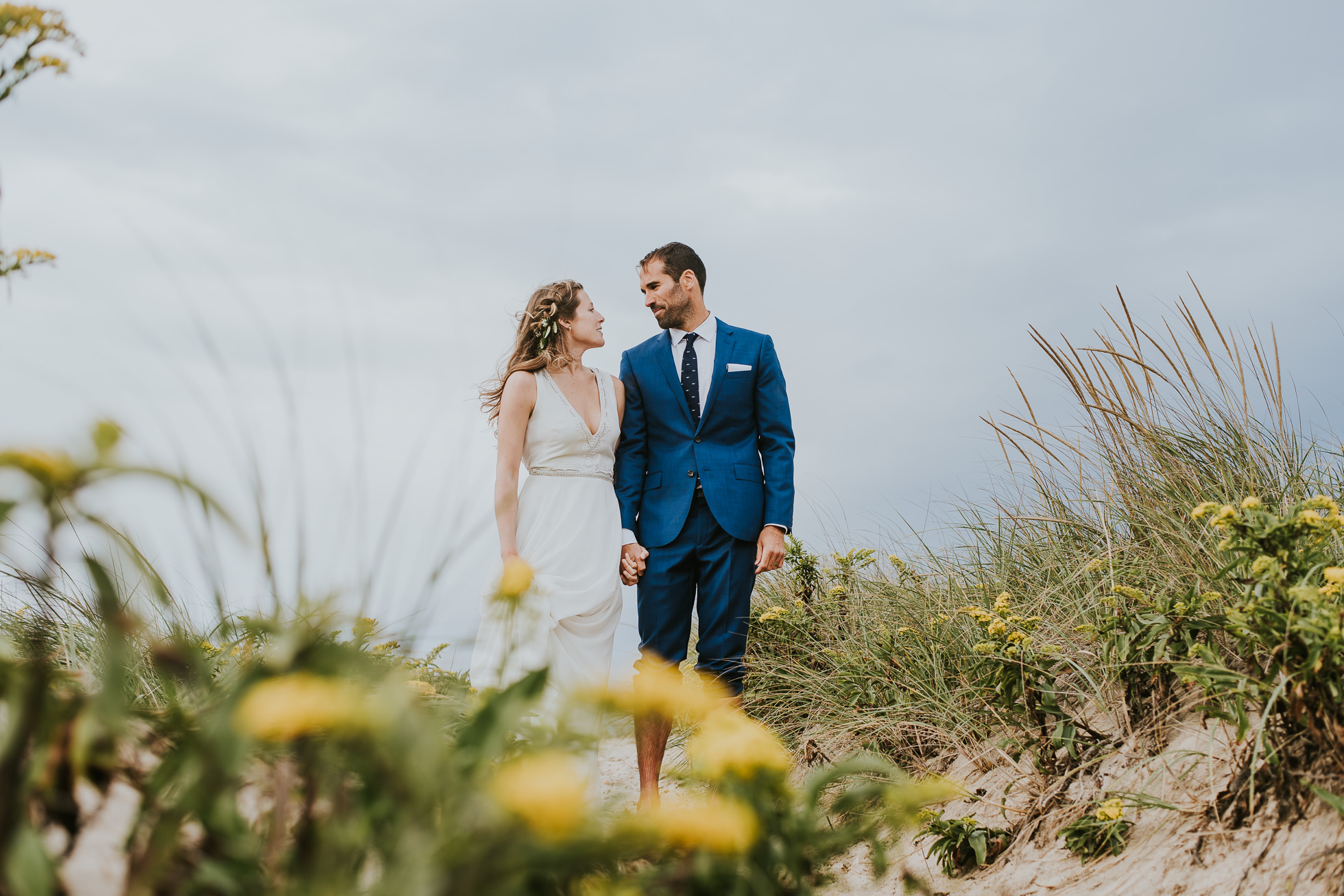 bride and groom in the sand dunes Montauk wedding photographed by Traverse the Tides