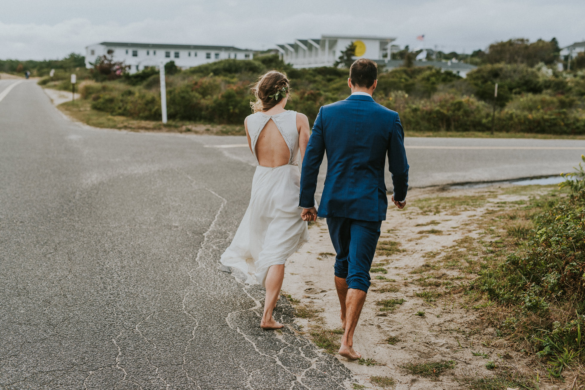 bride and groom walking down the road in Montauk wedding photographed by Traverse the Tides