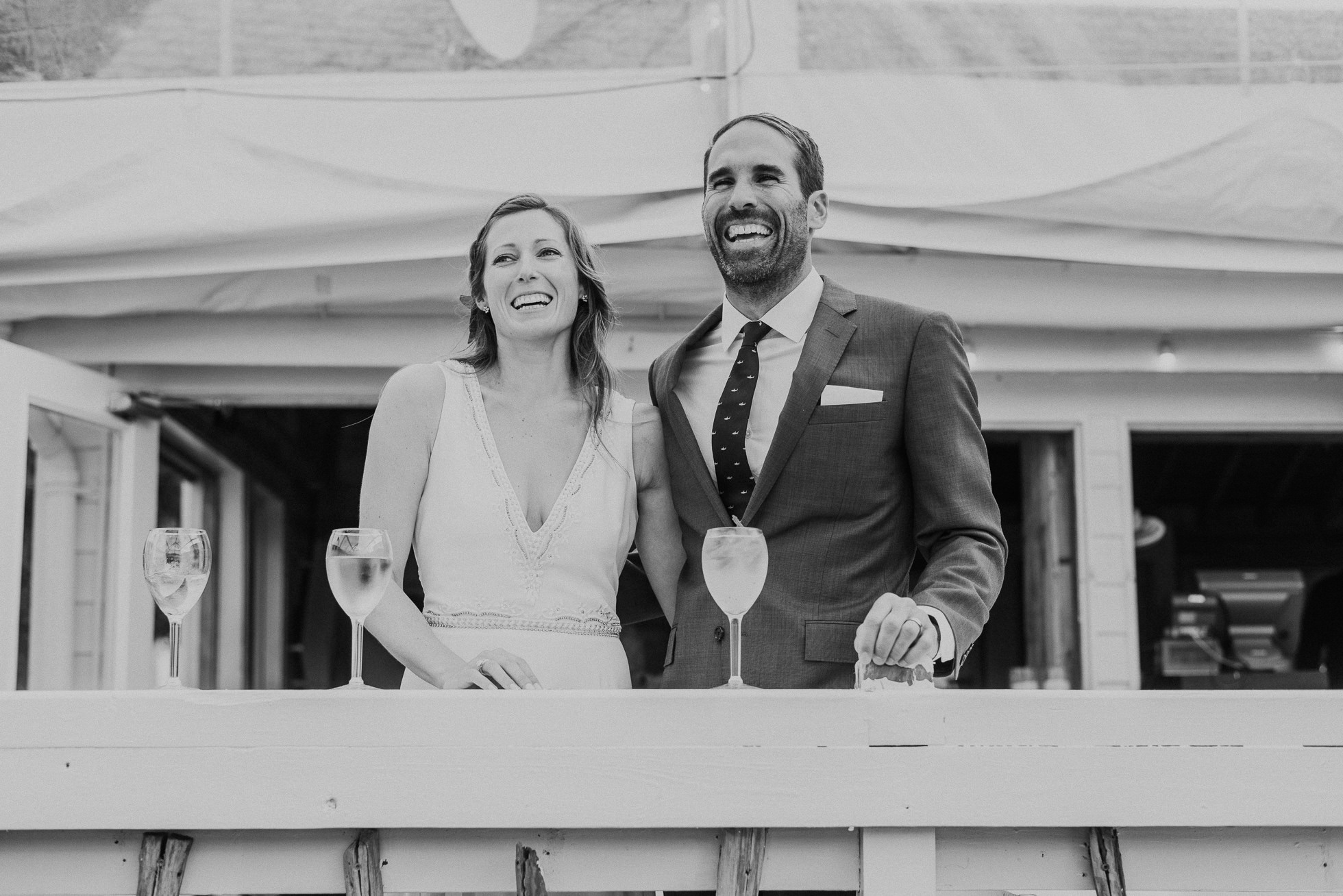 bride and groom laughing maid of honor speech at the surf lodge in Montauk wedding photographed by Traverse the Tides