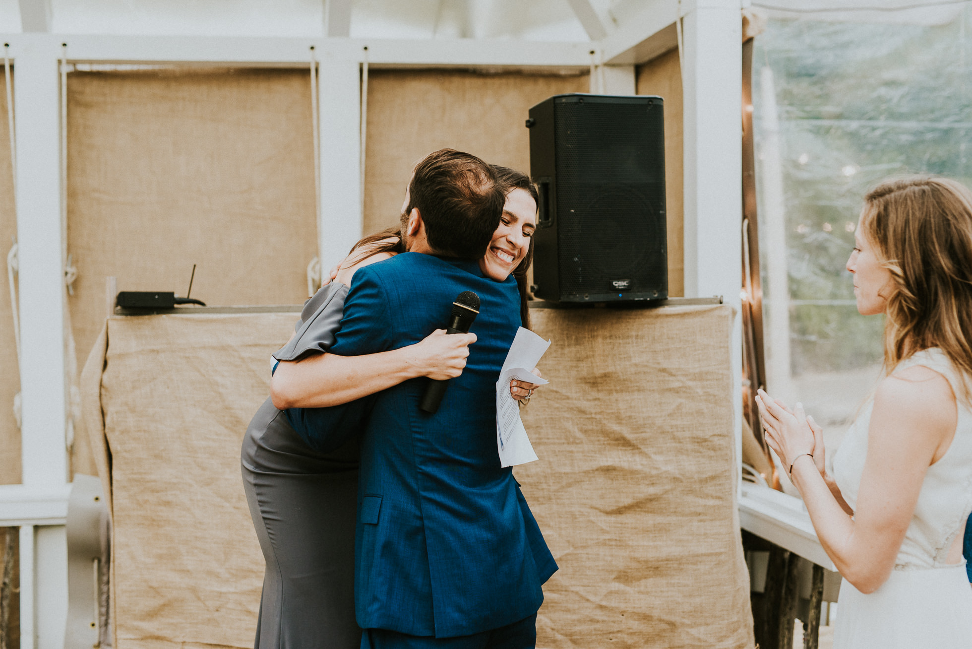groom hugging sister at the surf lodge Montauk wedding photographed by Traverse the Tides