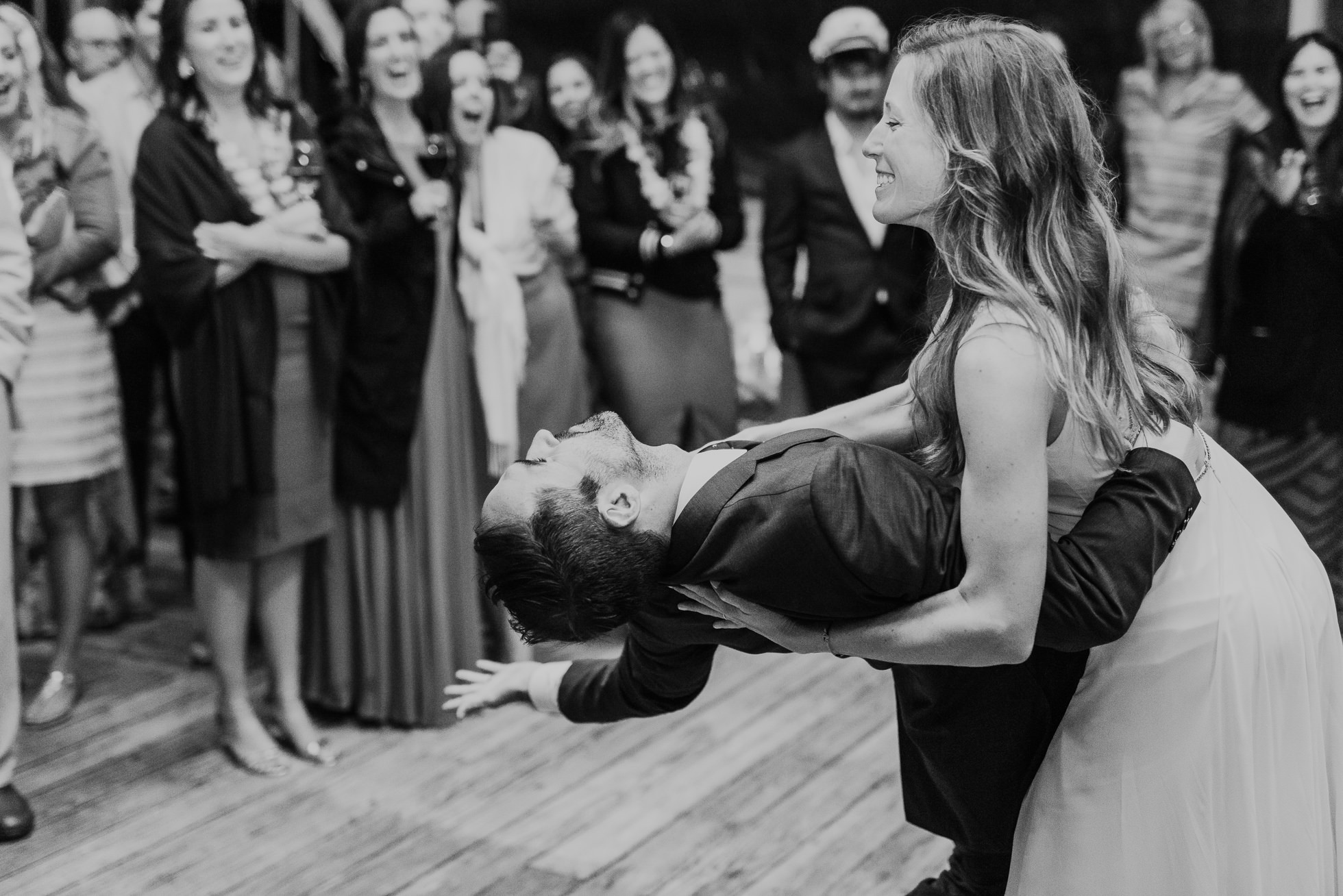 bride dipping groom first dance at the surf lodge reception Montauk wedding photographed by Traverse the Tides