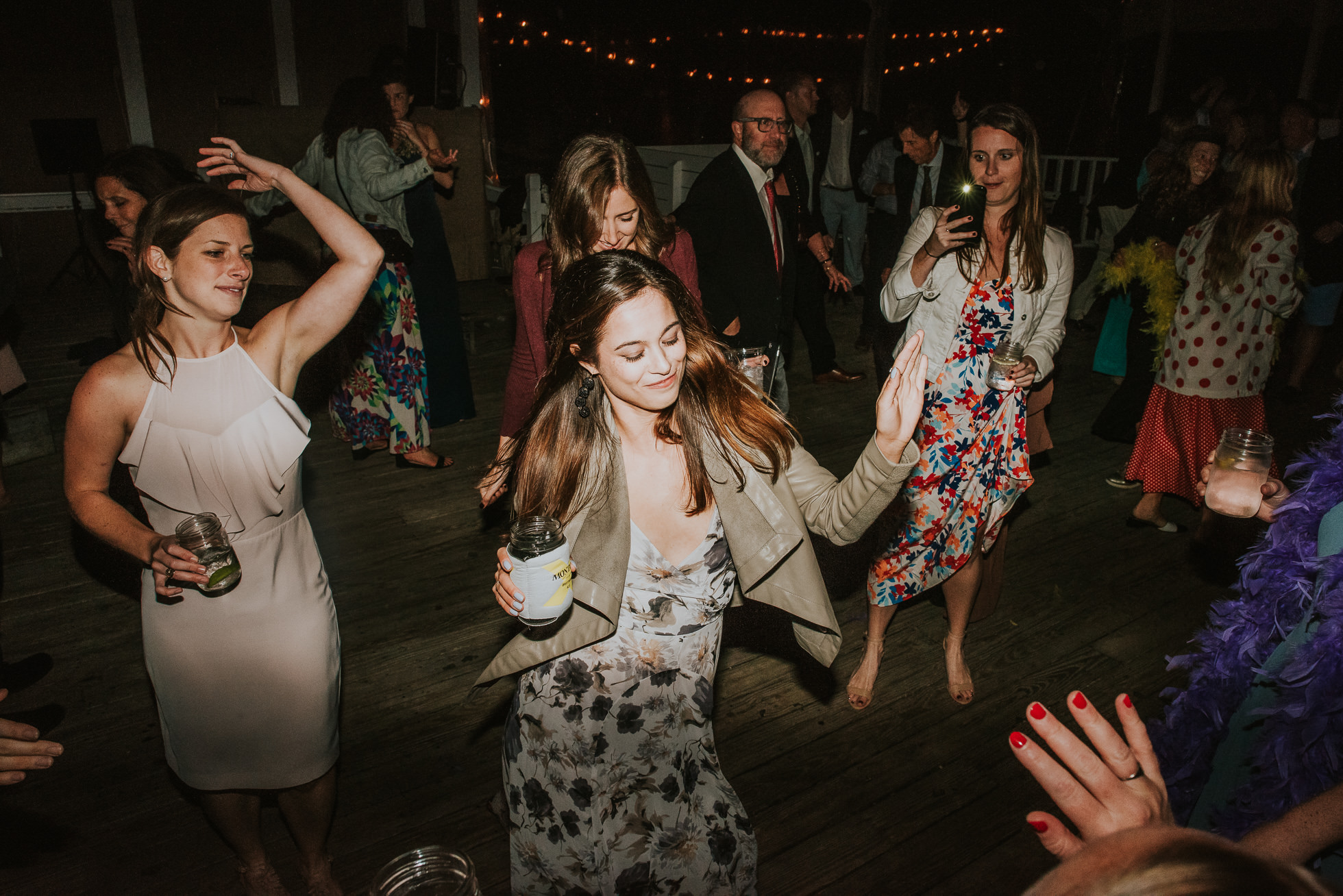 girl dancing at reception Montauk wedding photographed by Traverse the Tides