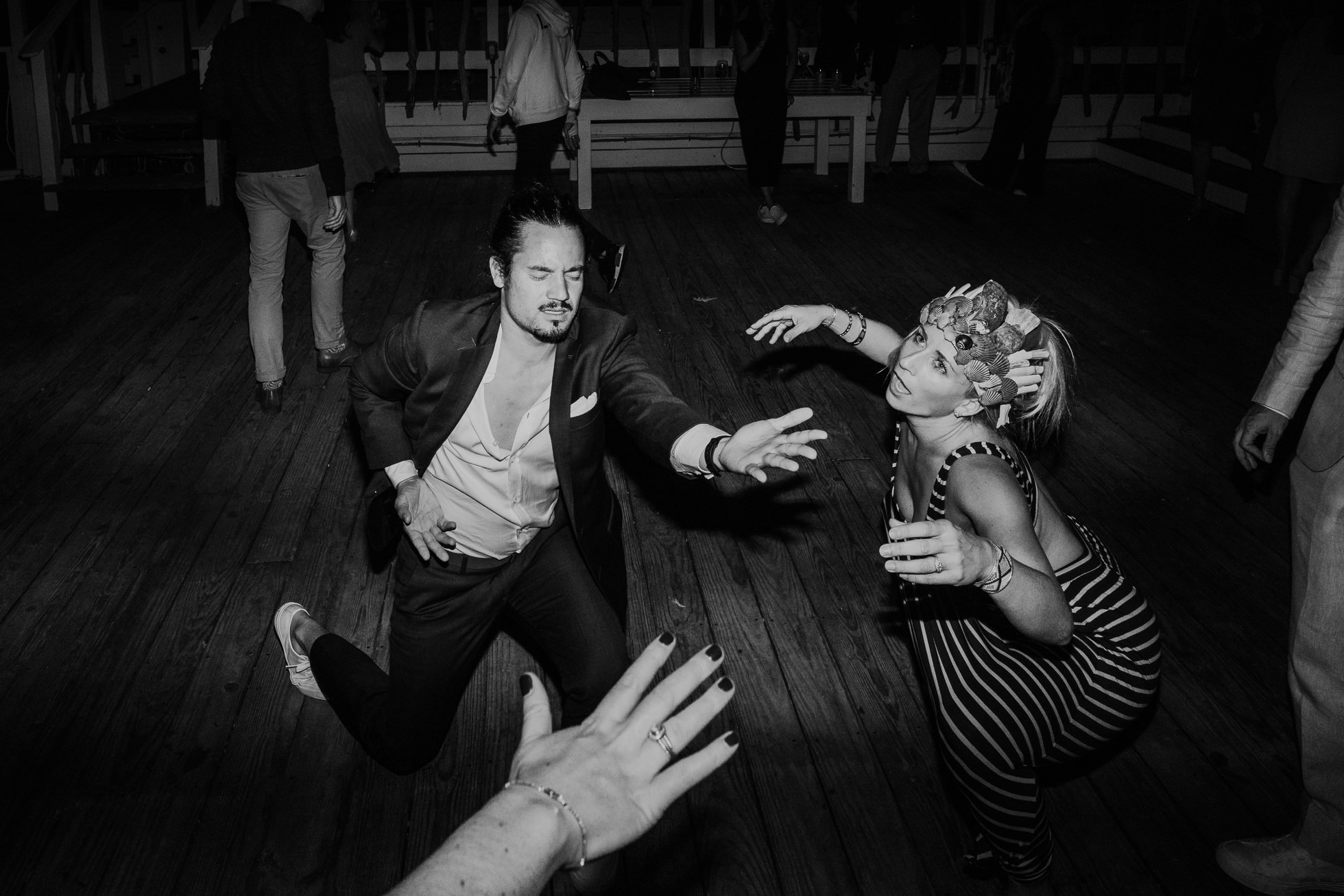 wild guests dancing at reception Montauk wedding photographed by Traverse the Tides