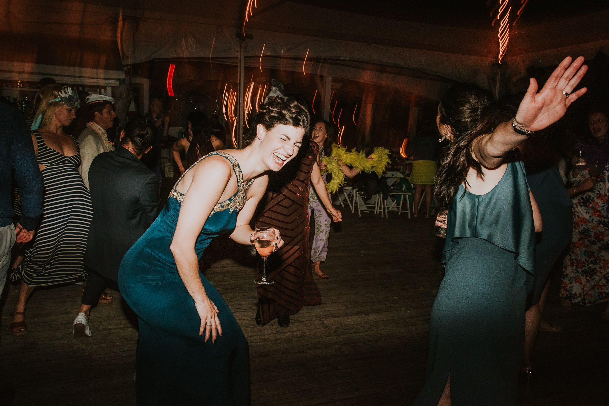 wild guests laughing at reception Montauk wedding photographed by Traverse the Tides