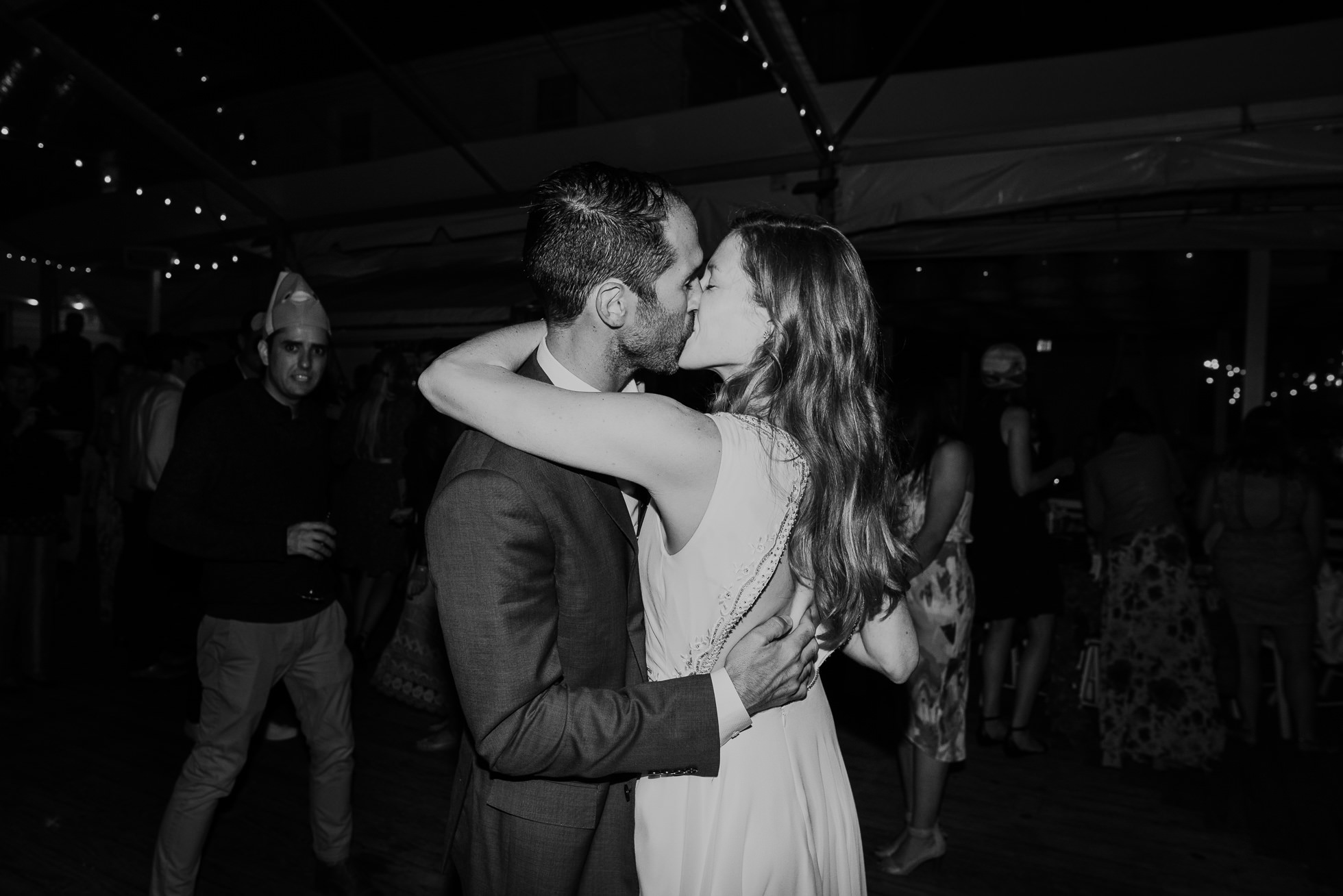 bride and groom kissing at reception Montauk wedding photographed by Traverse the Tides