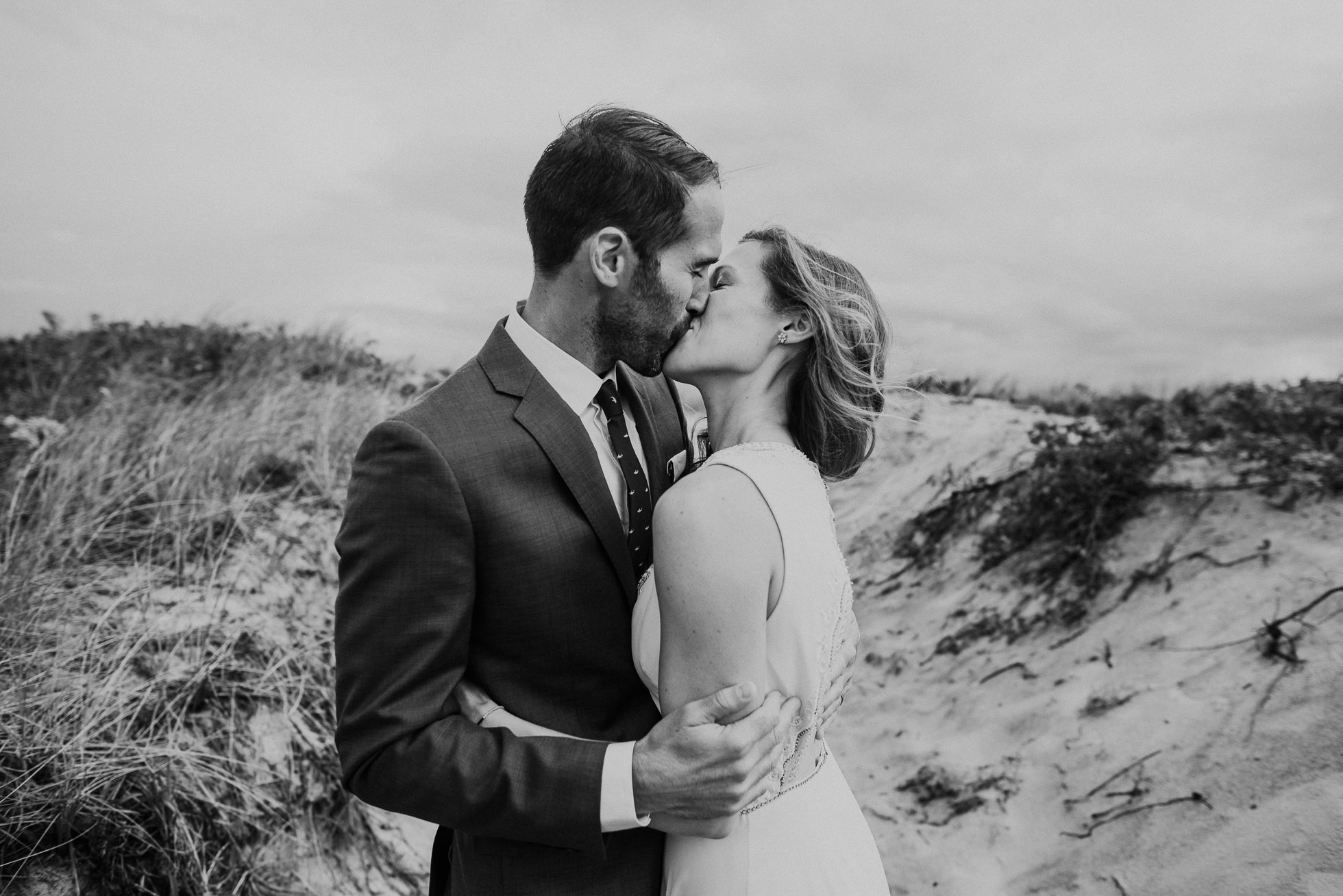 emotional kiss bride and groom at the beach Montauk wedding photographed by Traverse the Tides